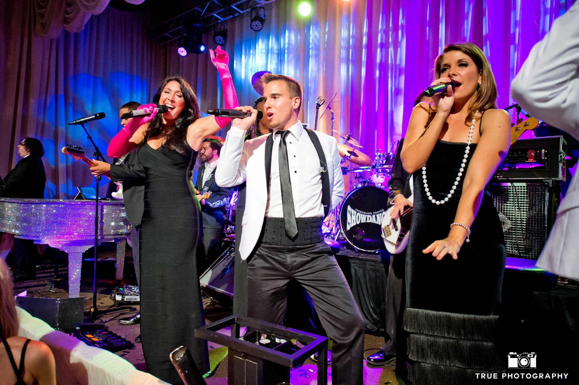 Fun, live band perform for guests during wedding reception