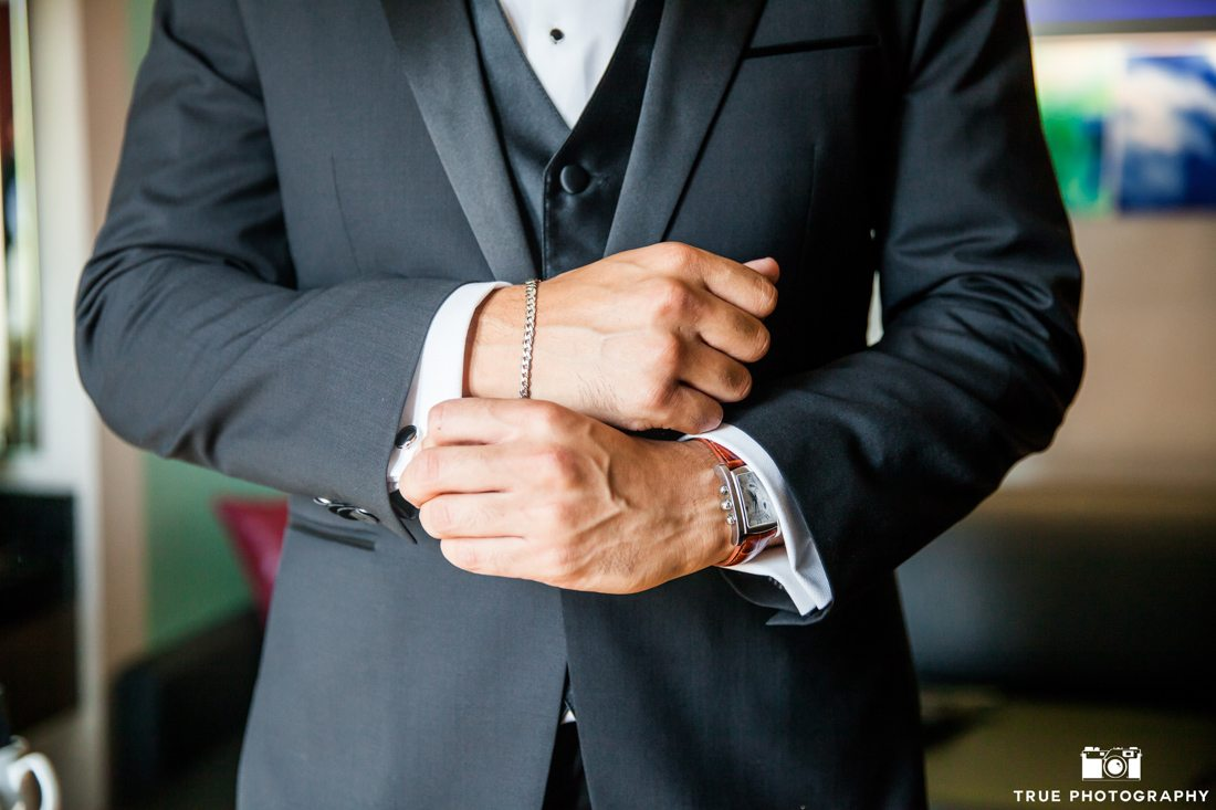 Close-up of groom bracelet cuff links and watch