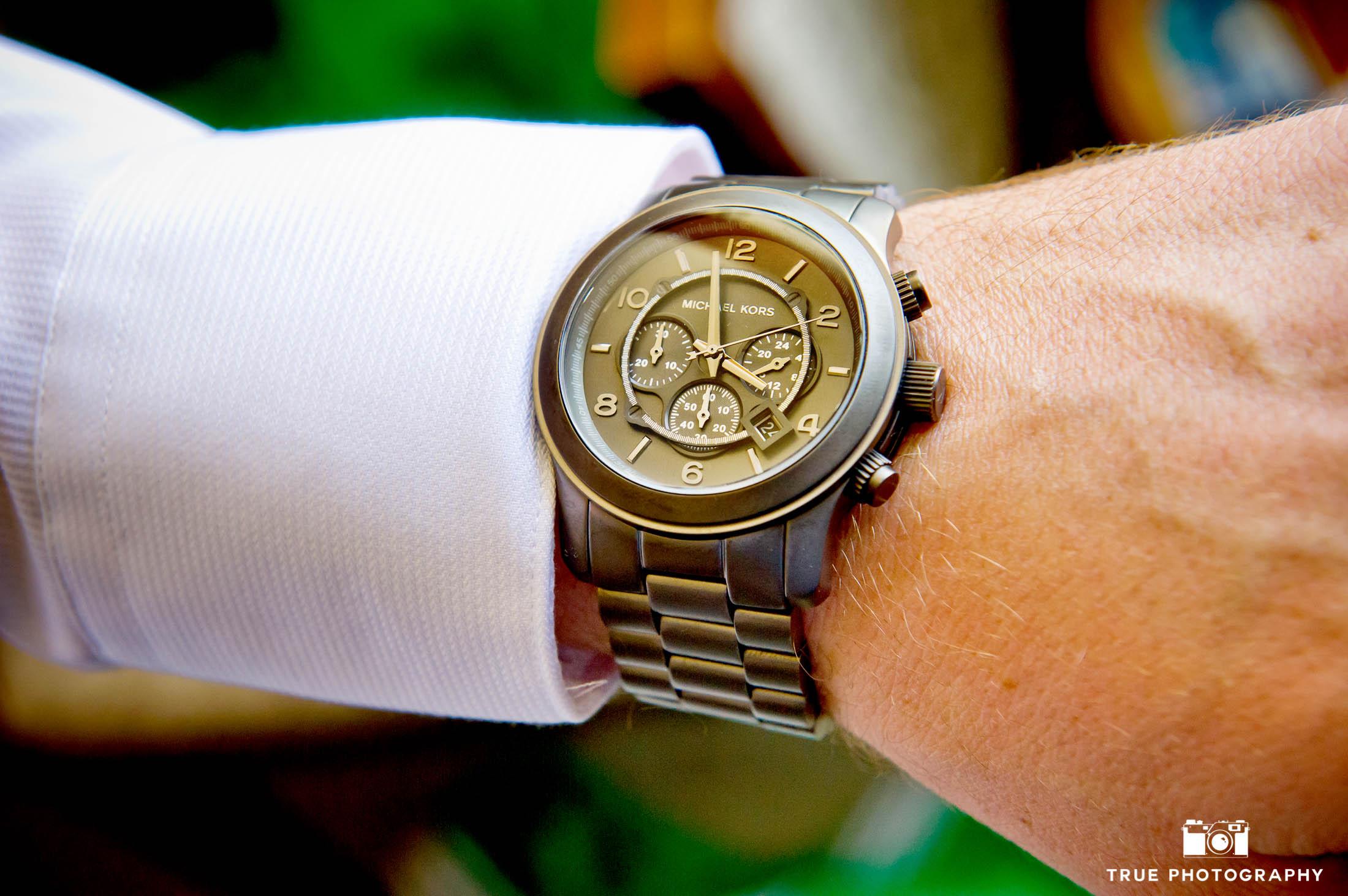 Groom shows off fancy watch