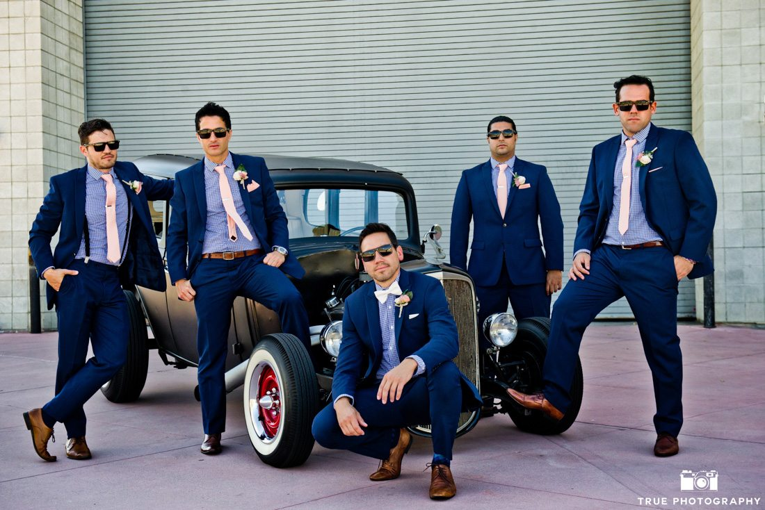 Fashionable Groomsmen portrait in front of hot rod