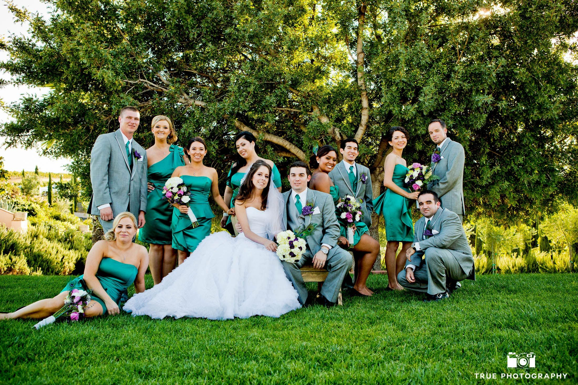 Cool bridal party dressed in green at winery wedding