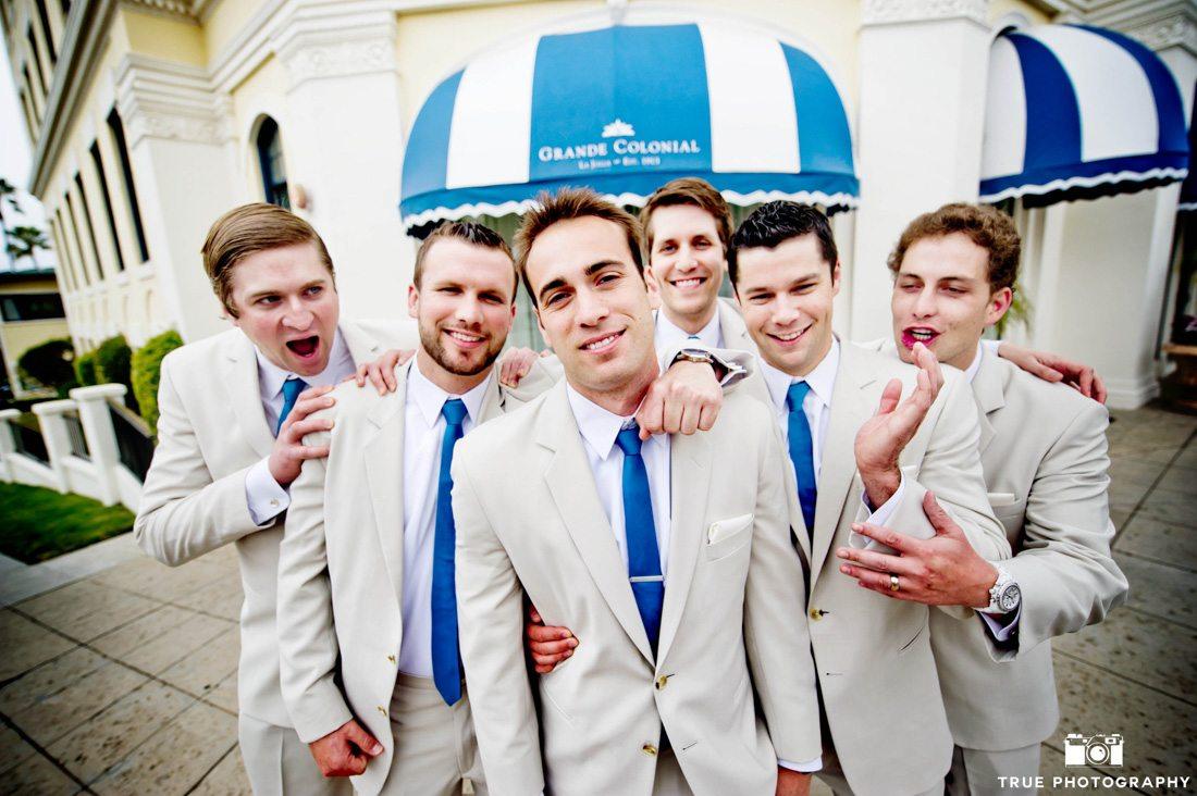fun group of stylish groomsmen