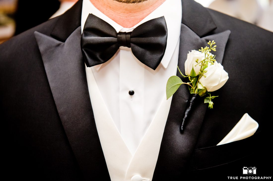 Close-up of a black tuxedo and bowtie