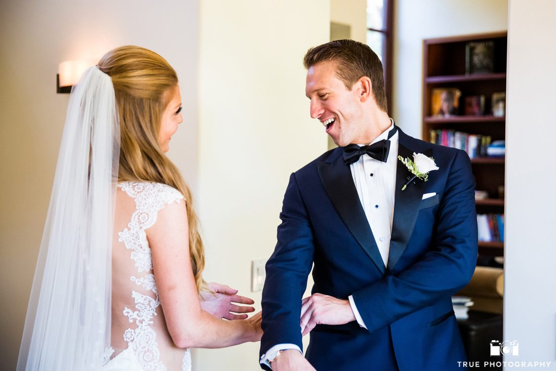 Happy groom seeing Bride for the first time in a stylish navy tuxedo