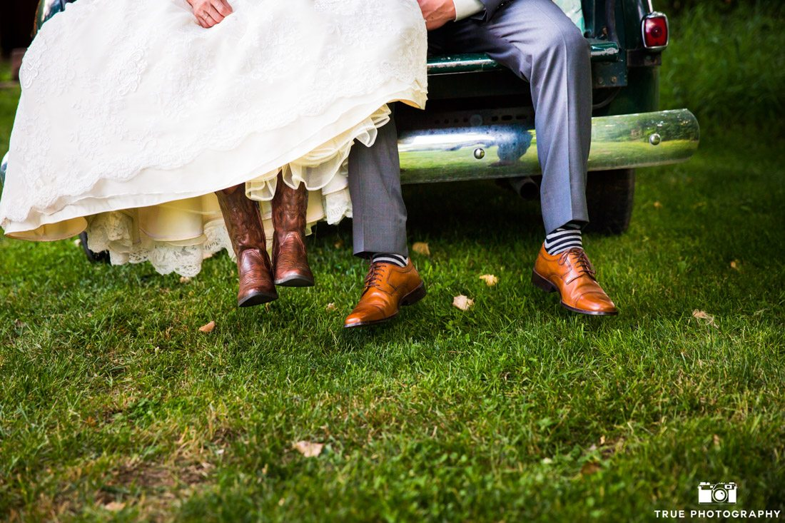 Bride wearing cowboy boots and groom wearing brown dress shoes