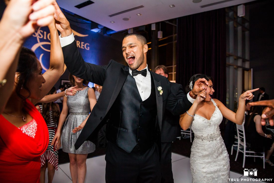 Dancing Groom Wearing Black Tuxedo