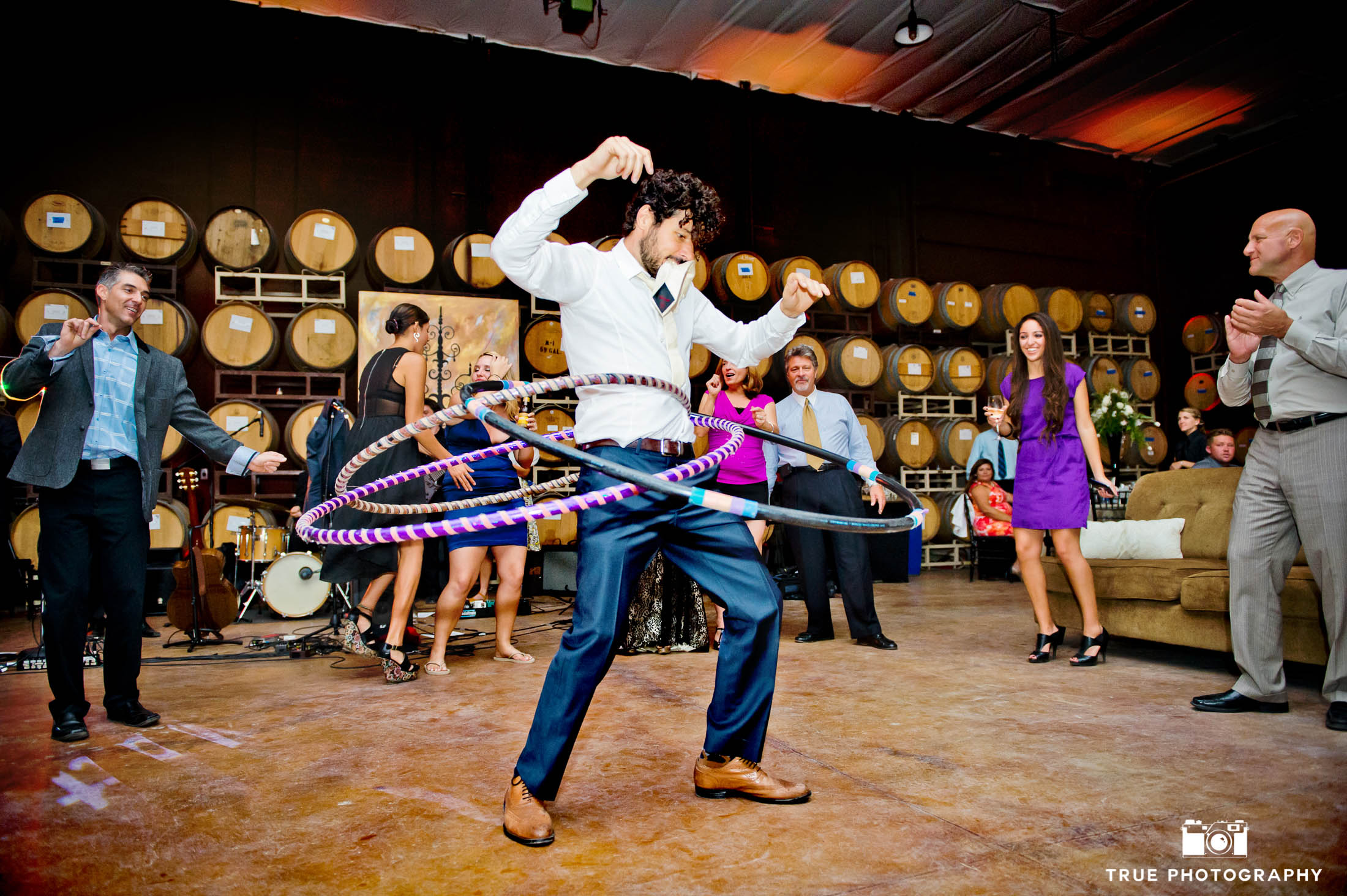 Guest hula-hoops during wedding reception