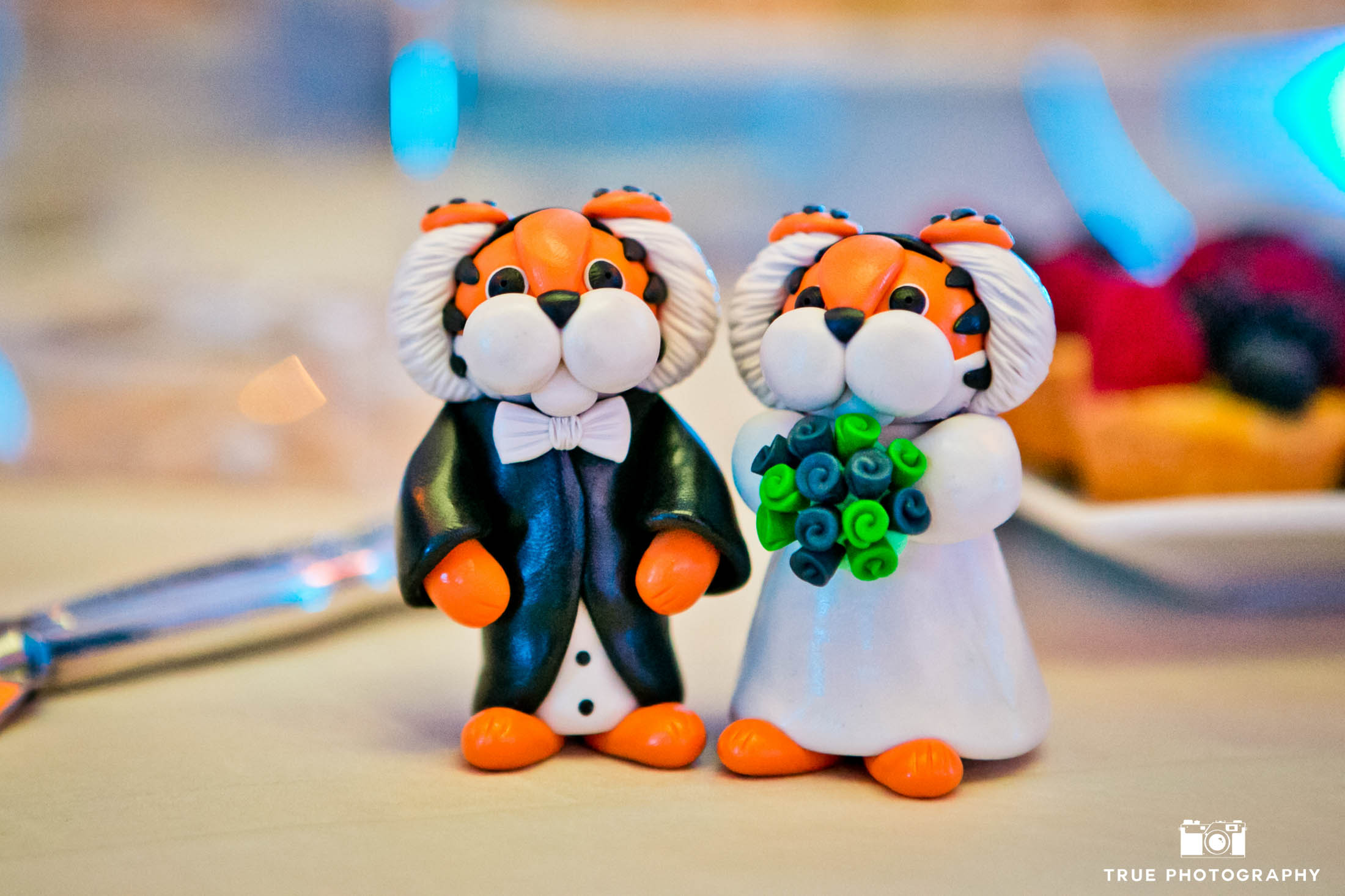 Cute, tiger-themed bride and groom cake topper