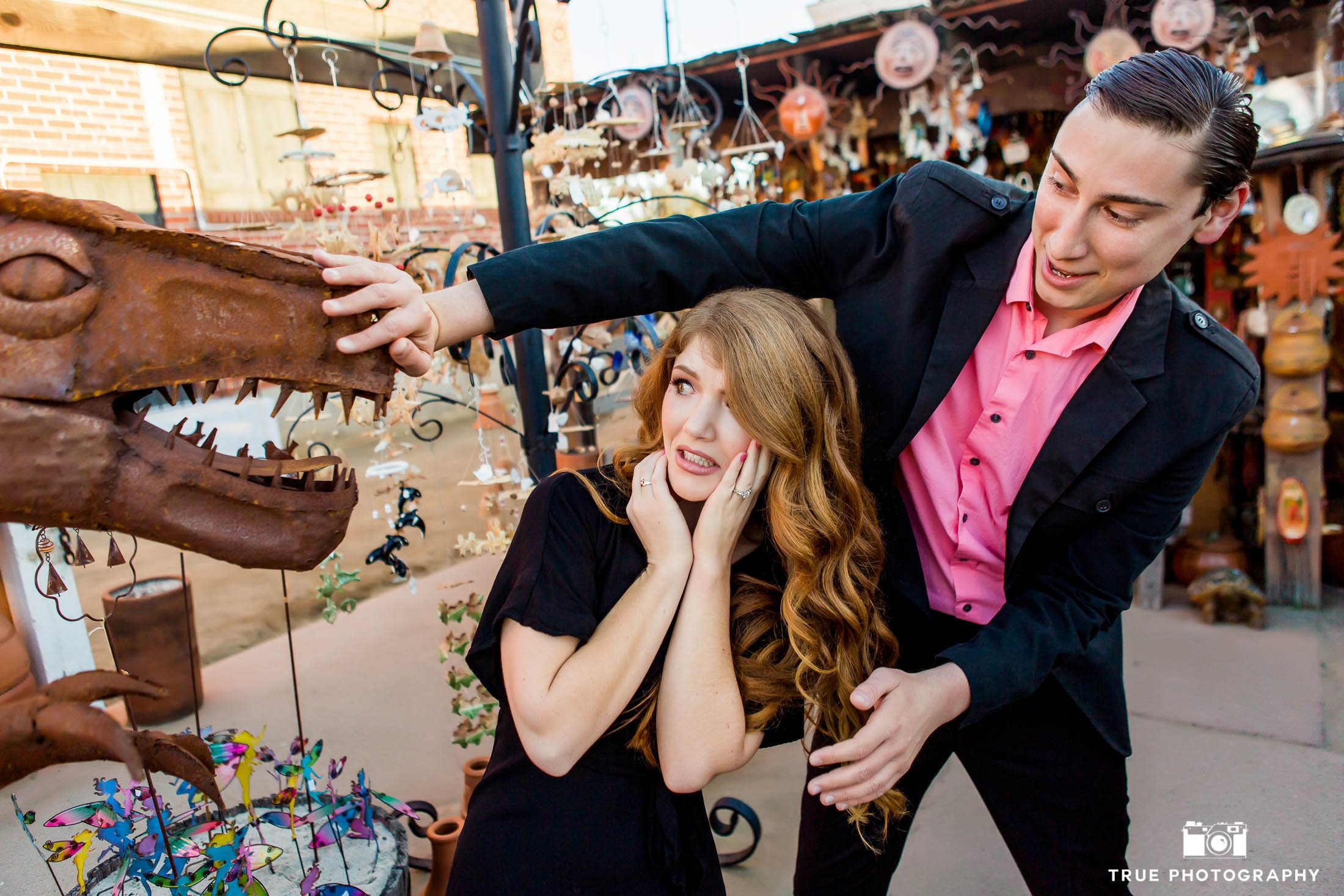 dinosaur garden sculpture funny old town engagement photo shoot photo