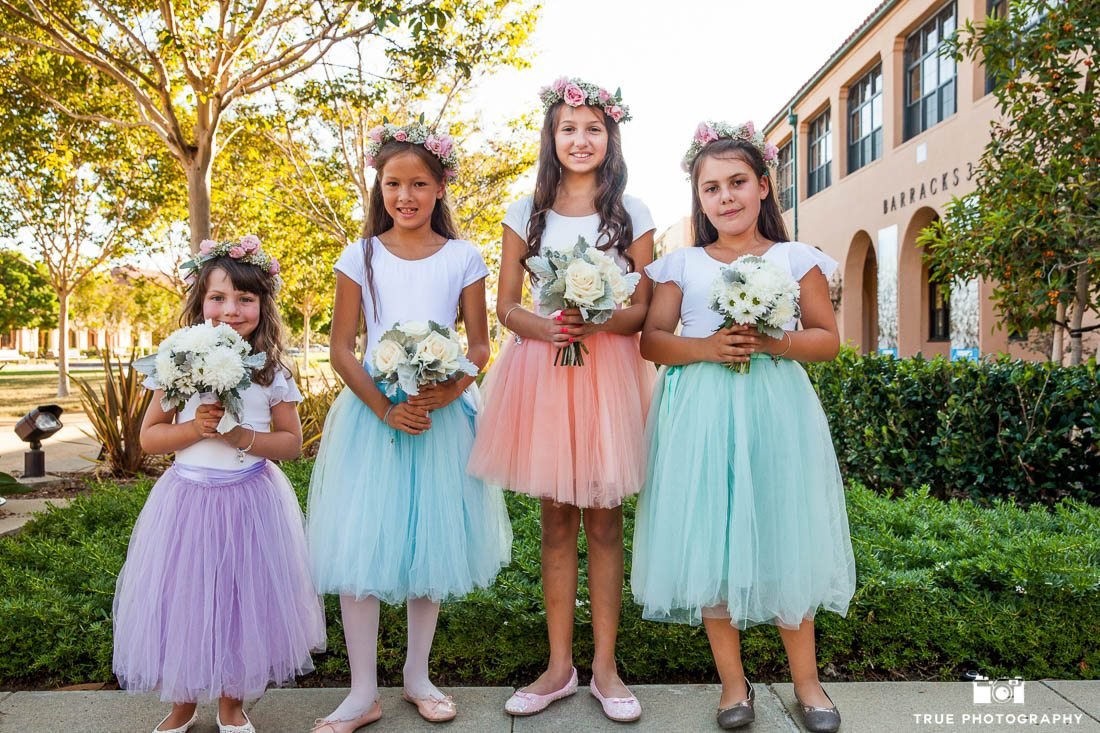 Flower girls in different colored tutus and flower crowns