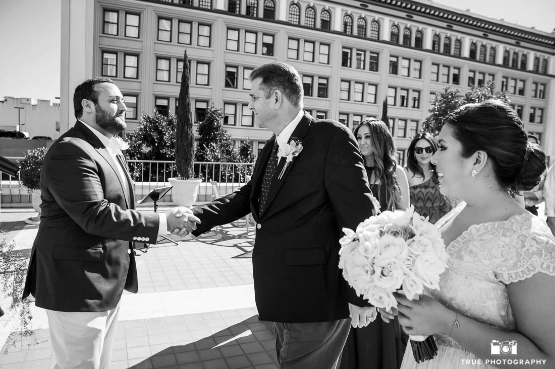 Groom shakes hands with father of bride in San Diego ceremony