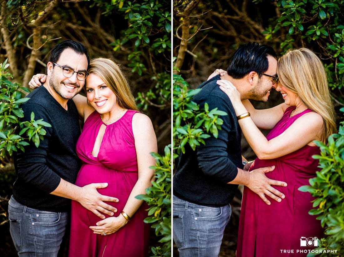 Husband touching wife's pregnant belly.