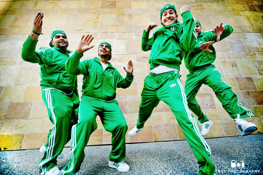 Groomsmen getting ready attire green adidas jumpsuits