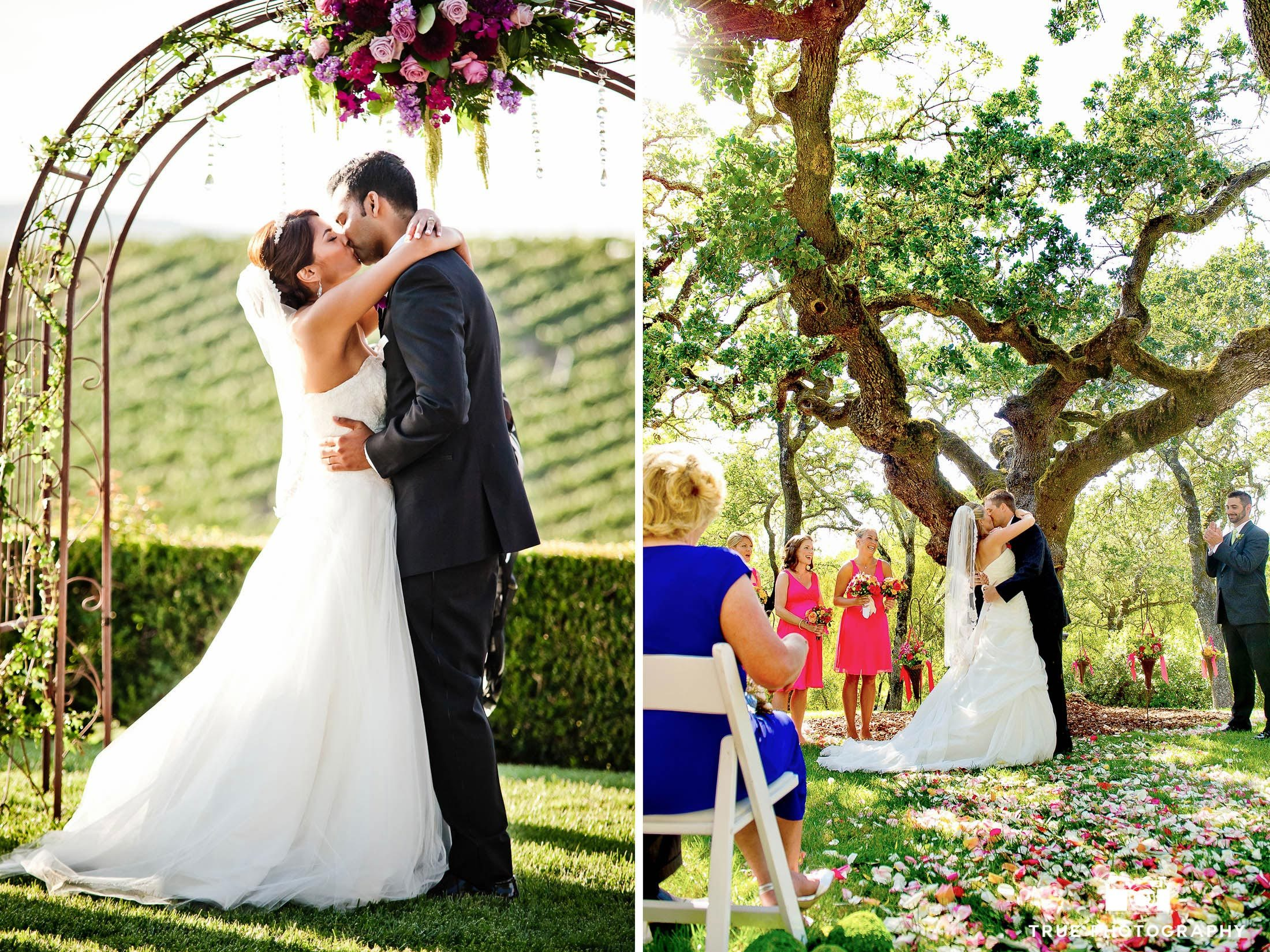 Couple's First Kiss during Vineyard Wedding