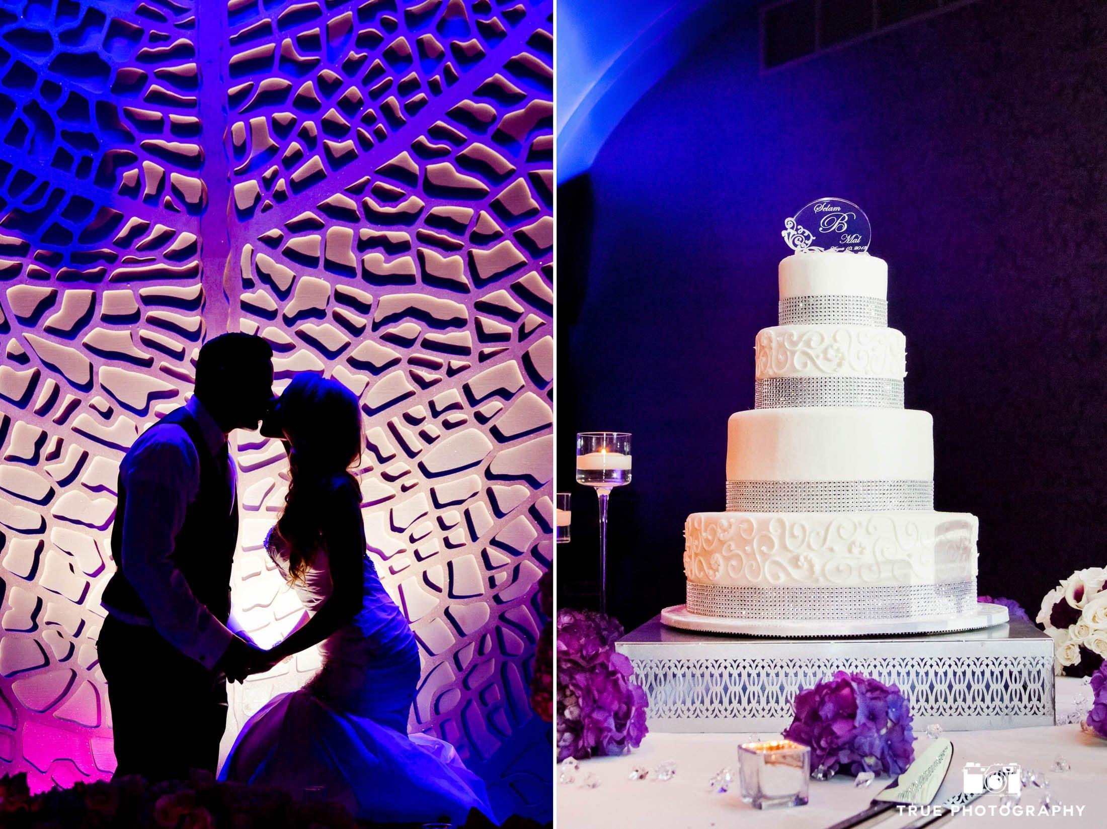 Modern wedding couple with dramatic purple background and purple wedding cake