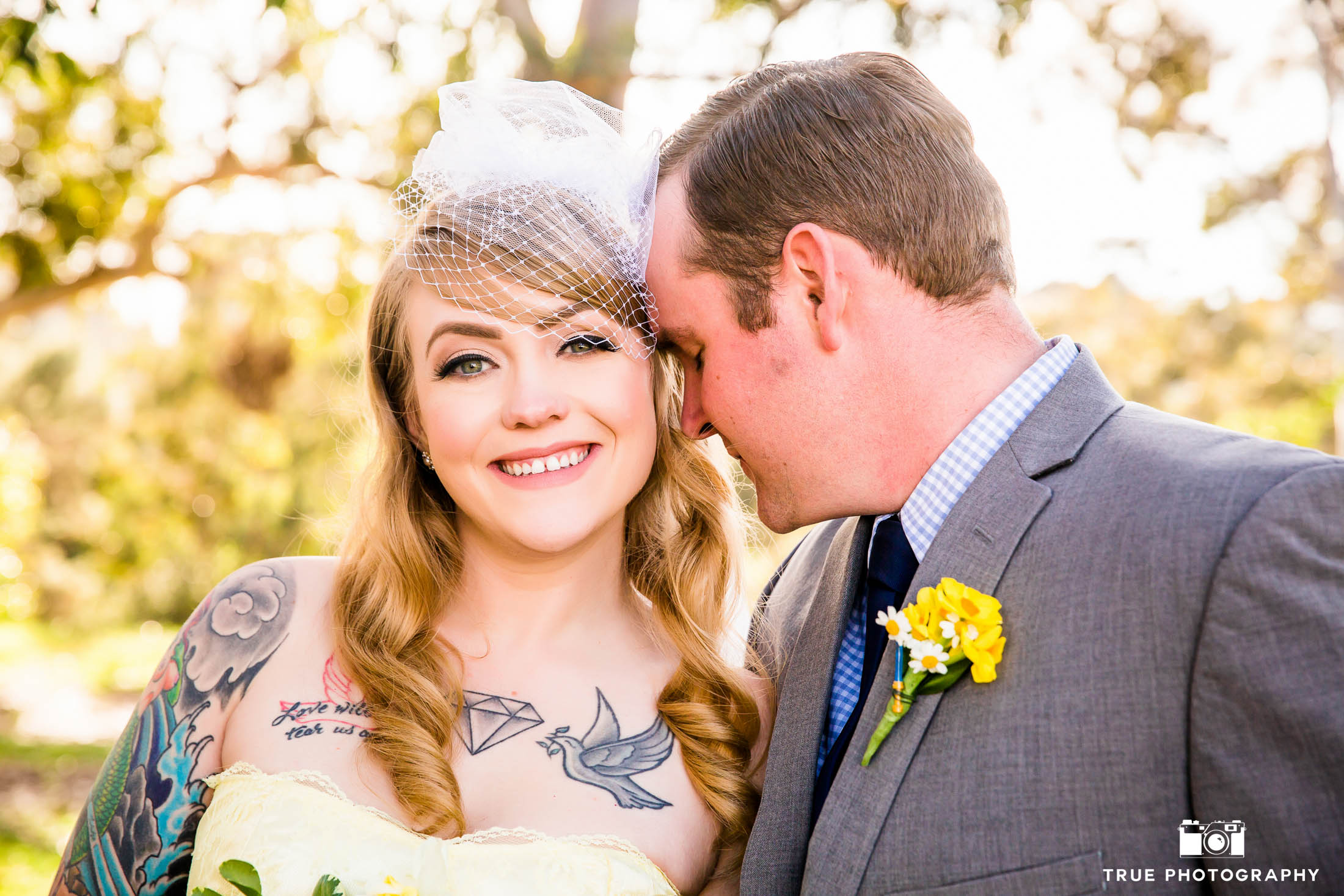 Bride and Groom touch foreheads in Balboa Park