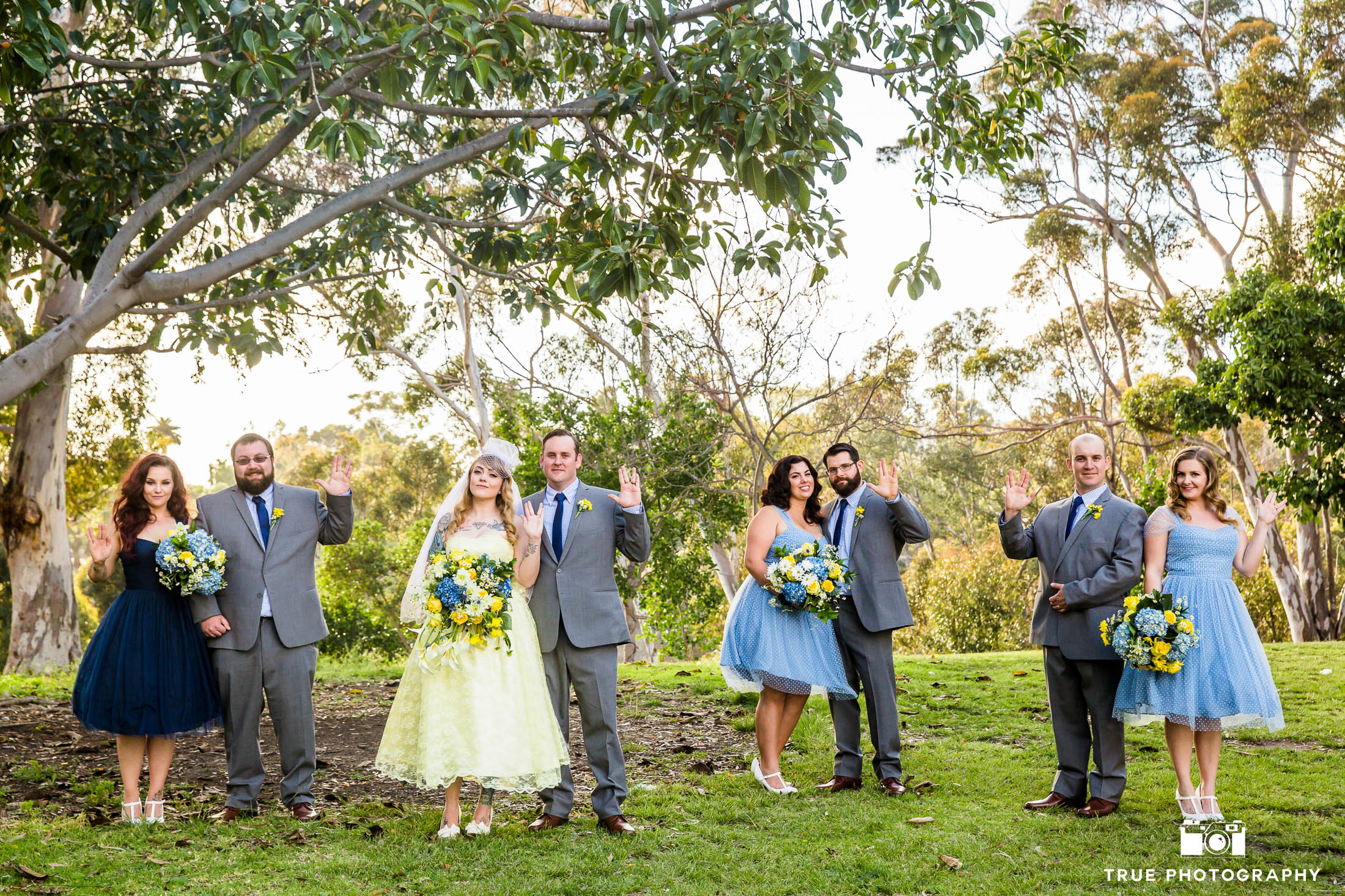 Bride and Groom pose with Bridal Party showing Star Trek Vulcan Salute