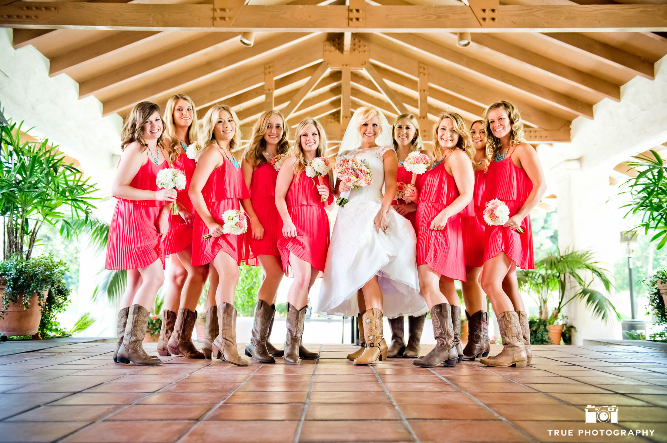 Bridesmaids and Bride show off fun rustic cowboy boots