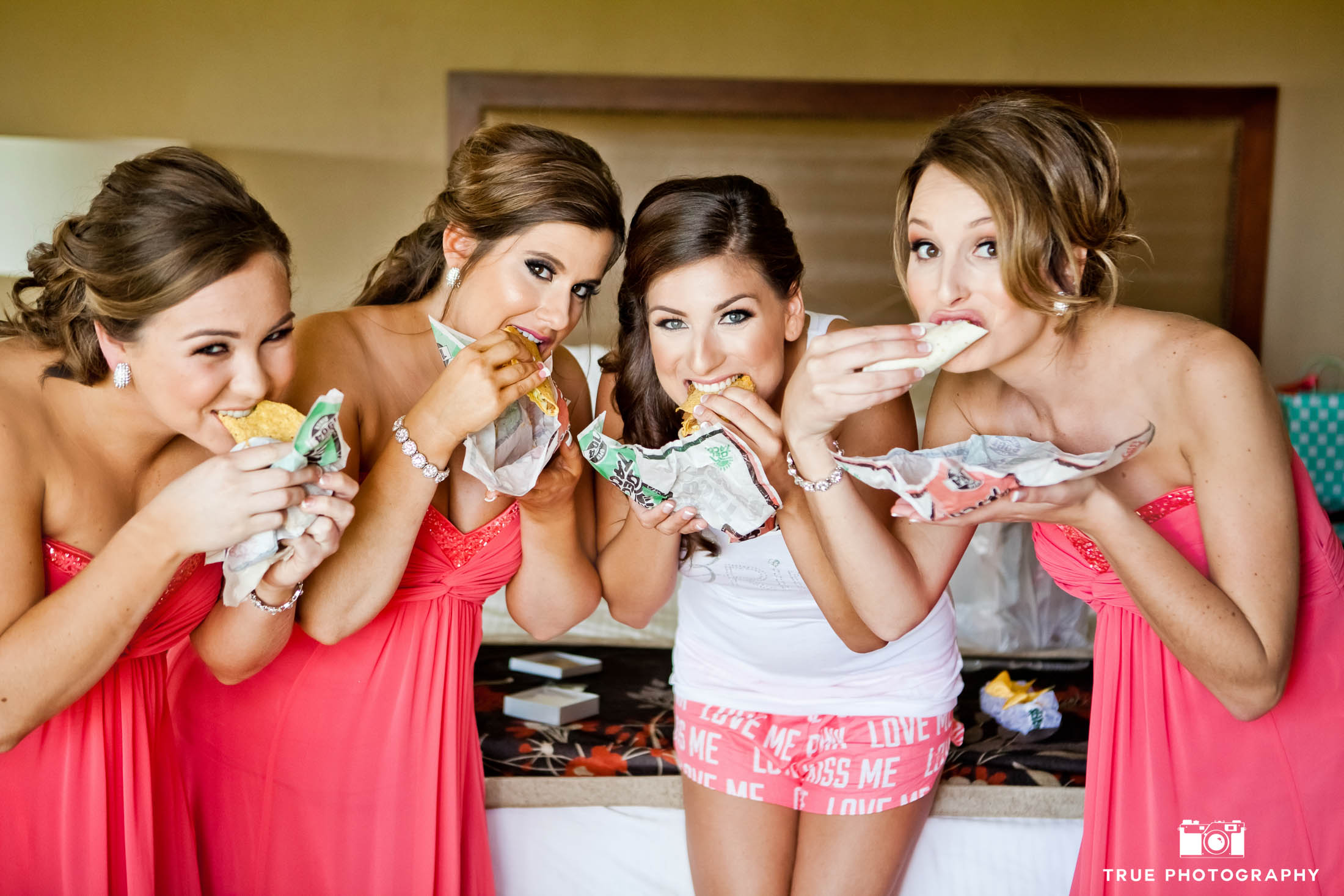 Bride and bridesmaids grab a bite of del taco before putting on the wedding dress