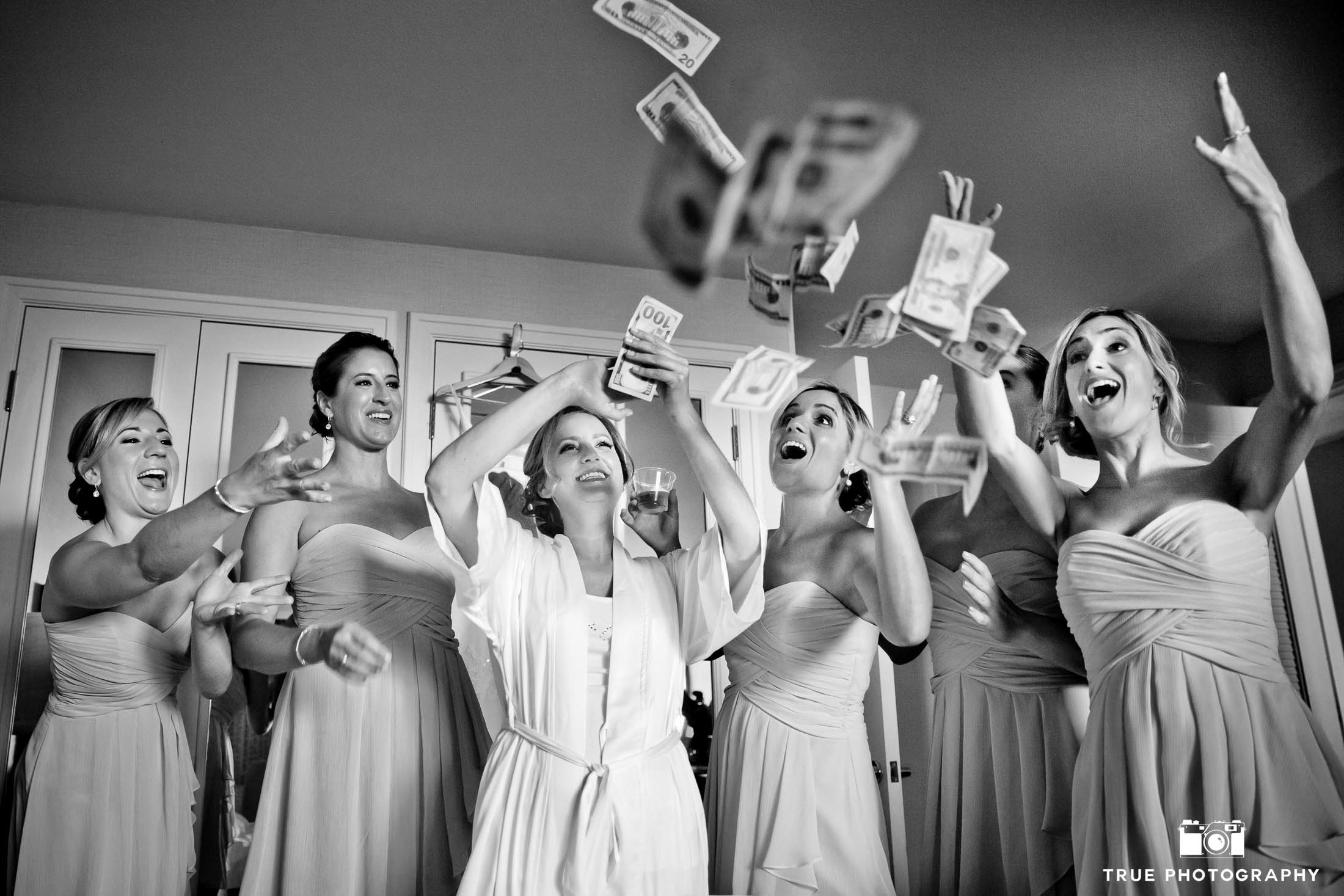 Bridesmaids make it rain as they toss money in the air before wedding ceremony