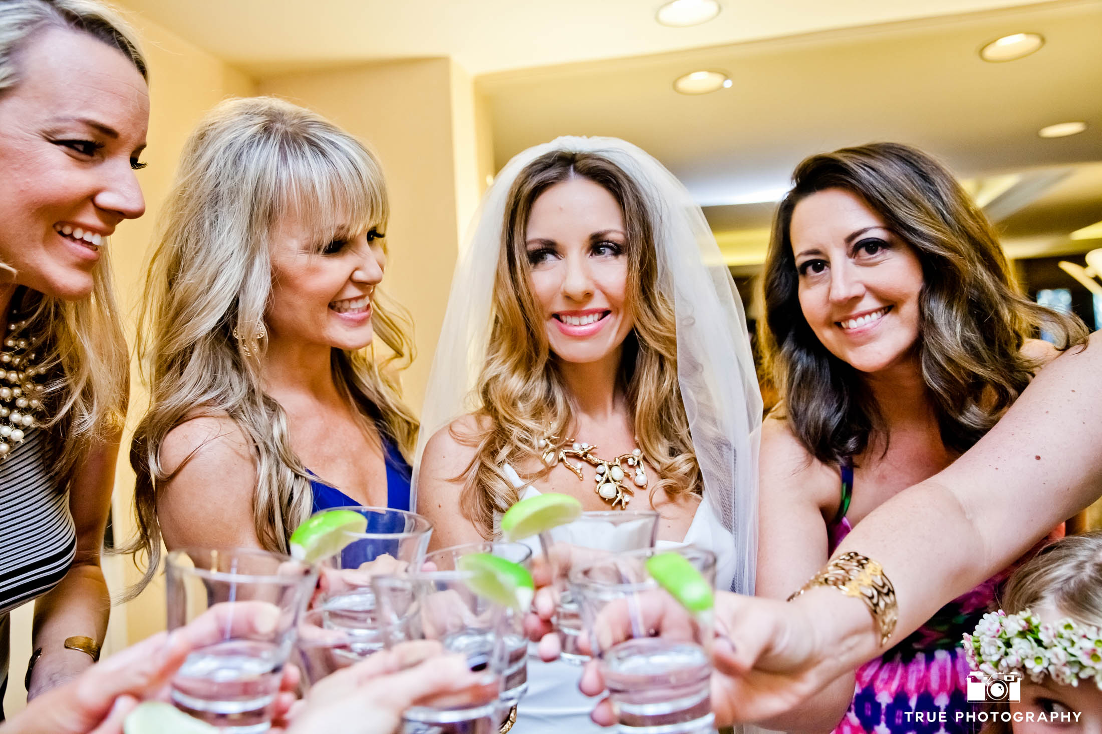 Bridesmaids toast with a shot of tequila before wedding ceremony