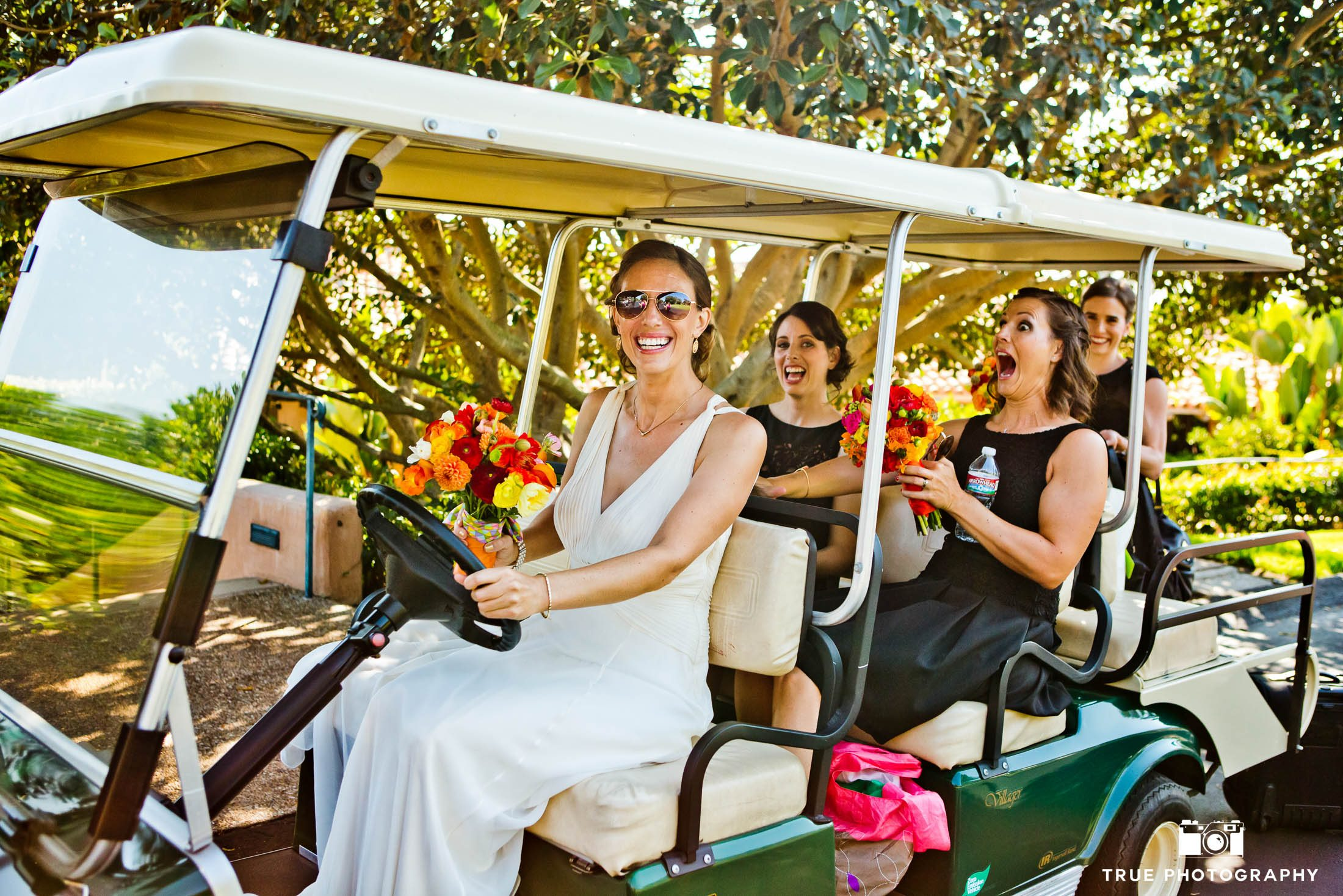 Bride drives her bridesmaids in golf cart