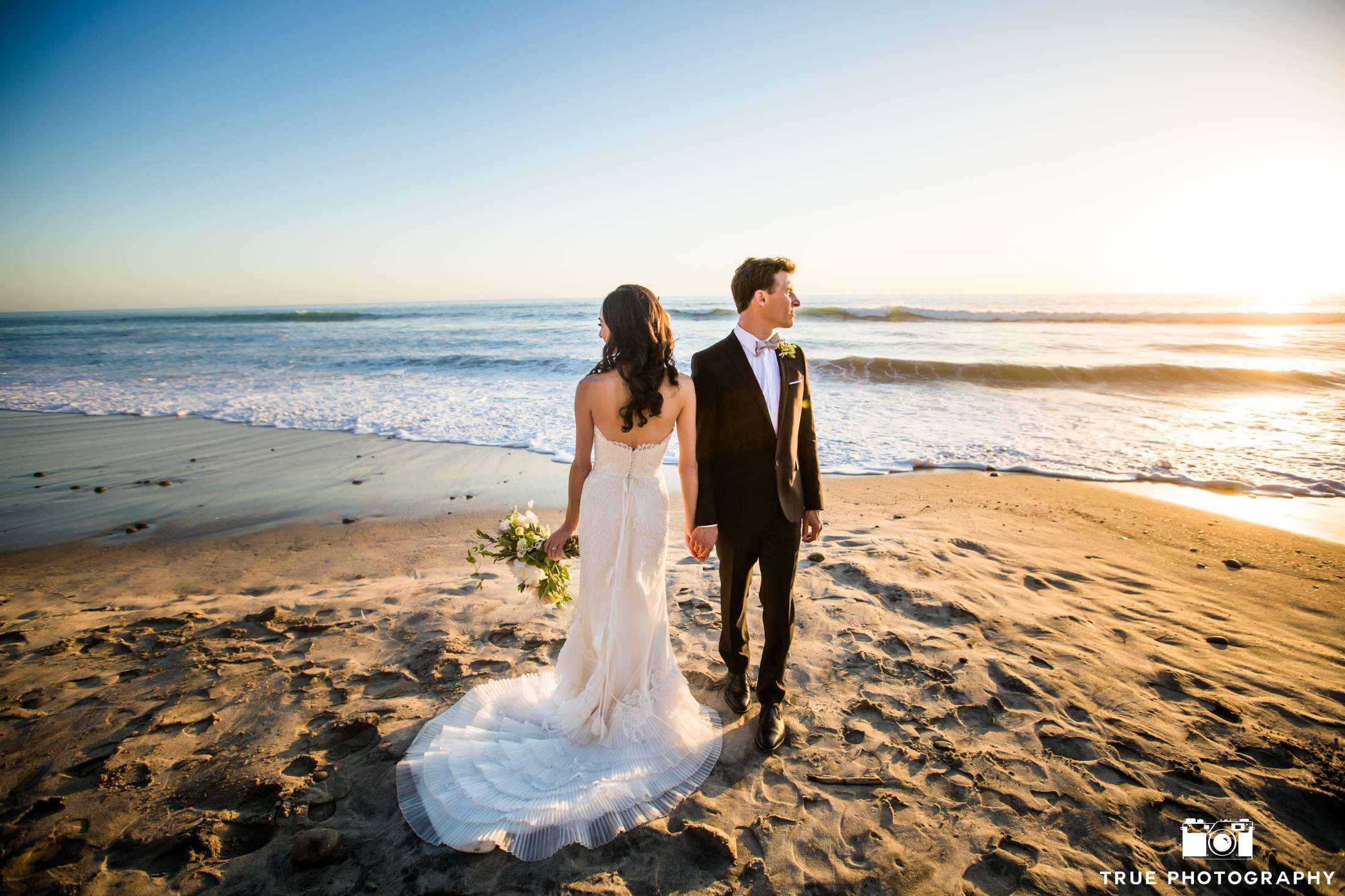 Cape Rey Carlsbad wedding couple on the beach during sunset