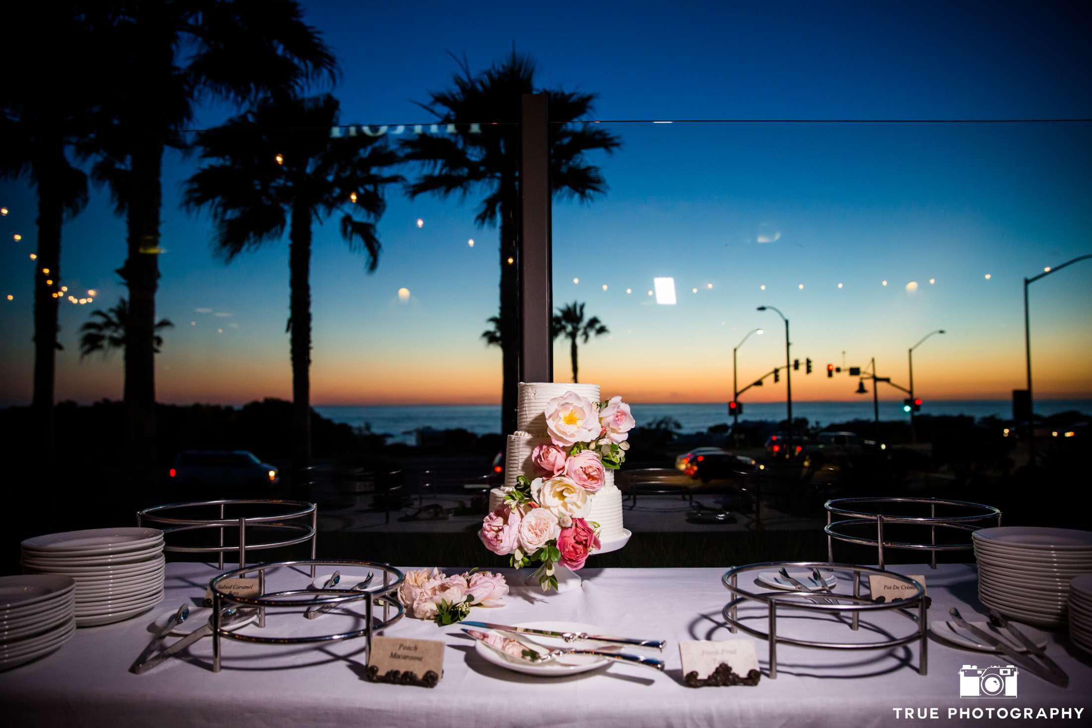 Cape Rey Carlsbad a Hilton Resort wedding cake during sunset
