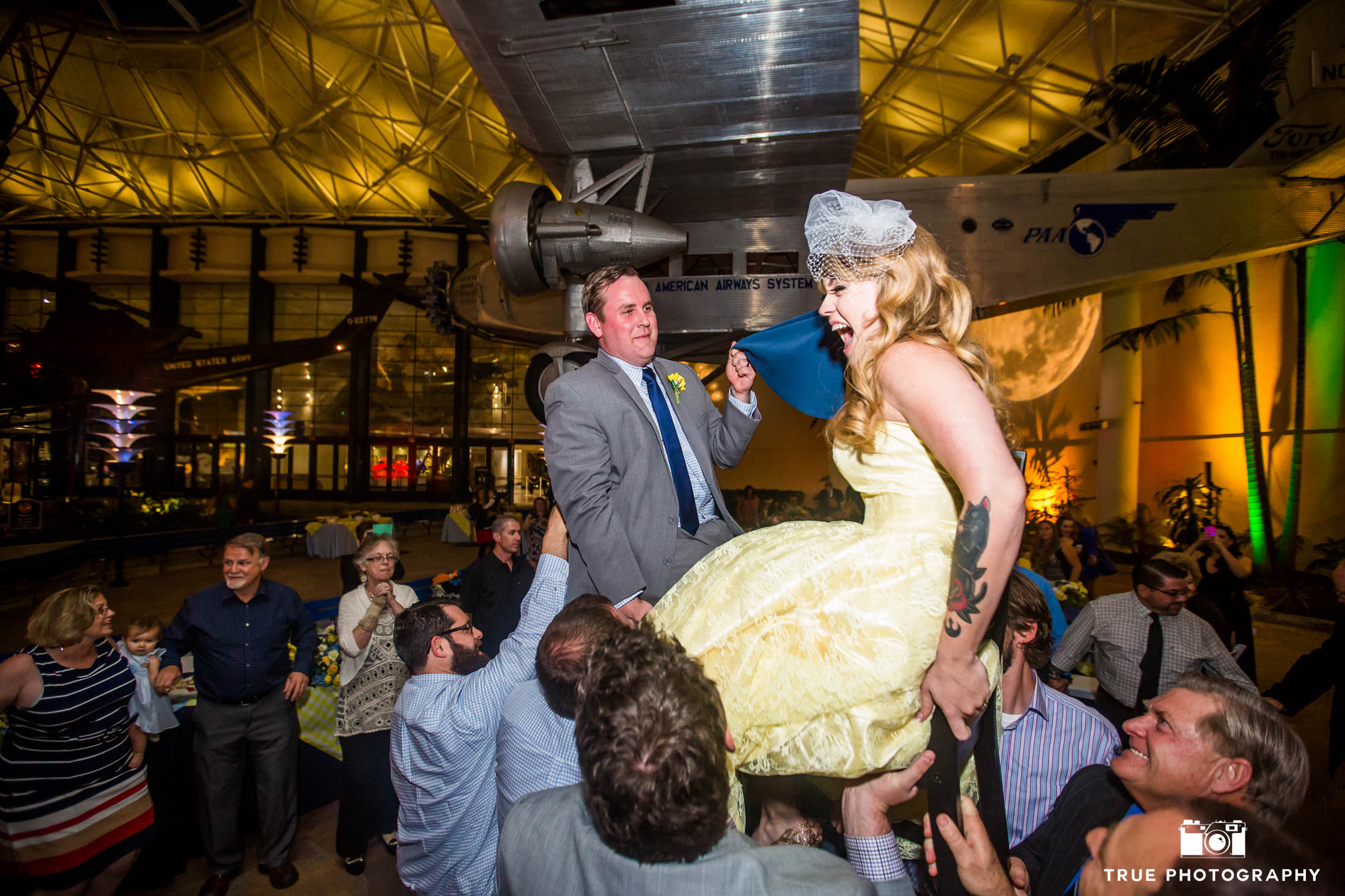 Guests lift Bride and Groom for Hora Dance during wedding reception