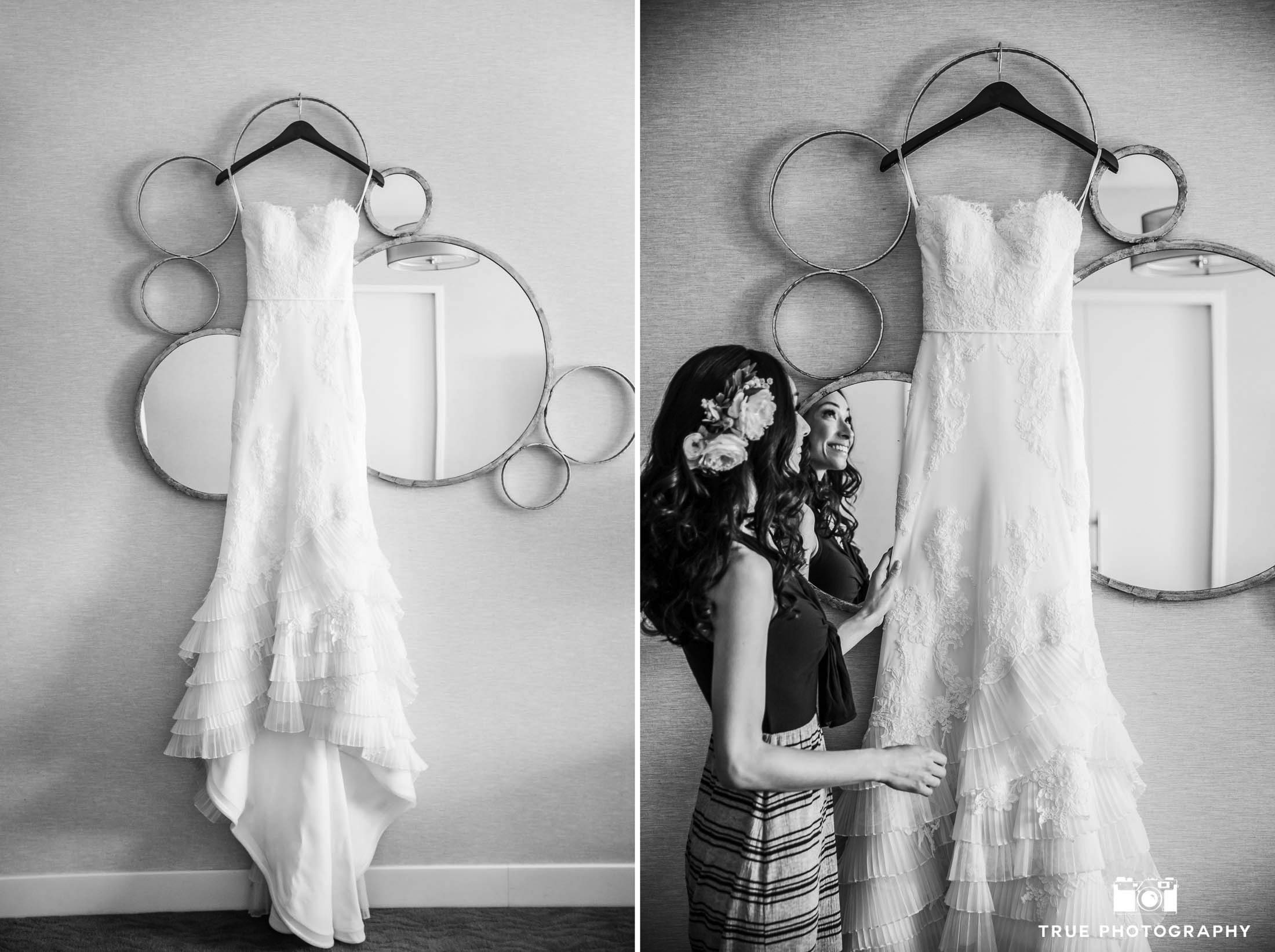 Bride getting ready with her dress hanging artistically at Hilton Resort Cape Rey Carlsbad