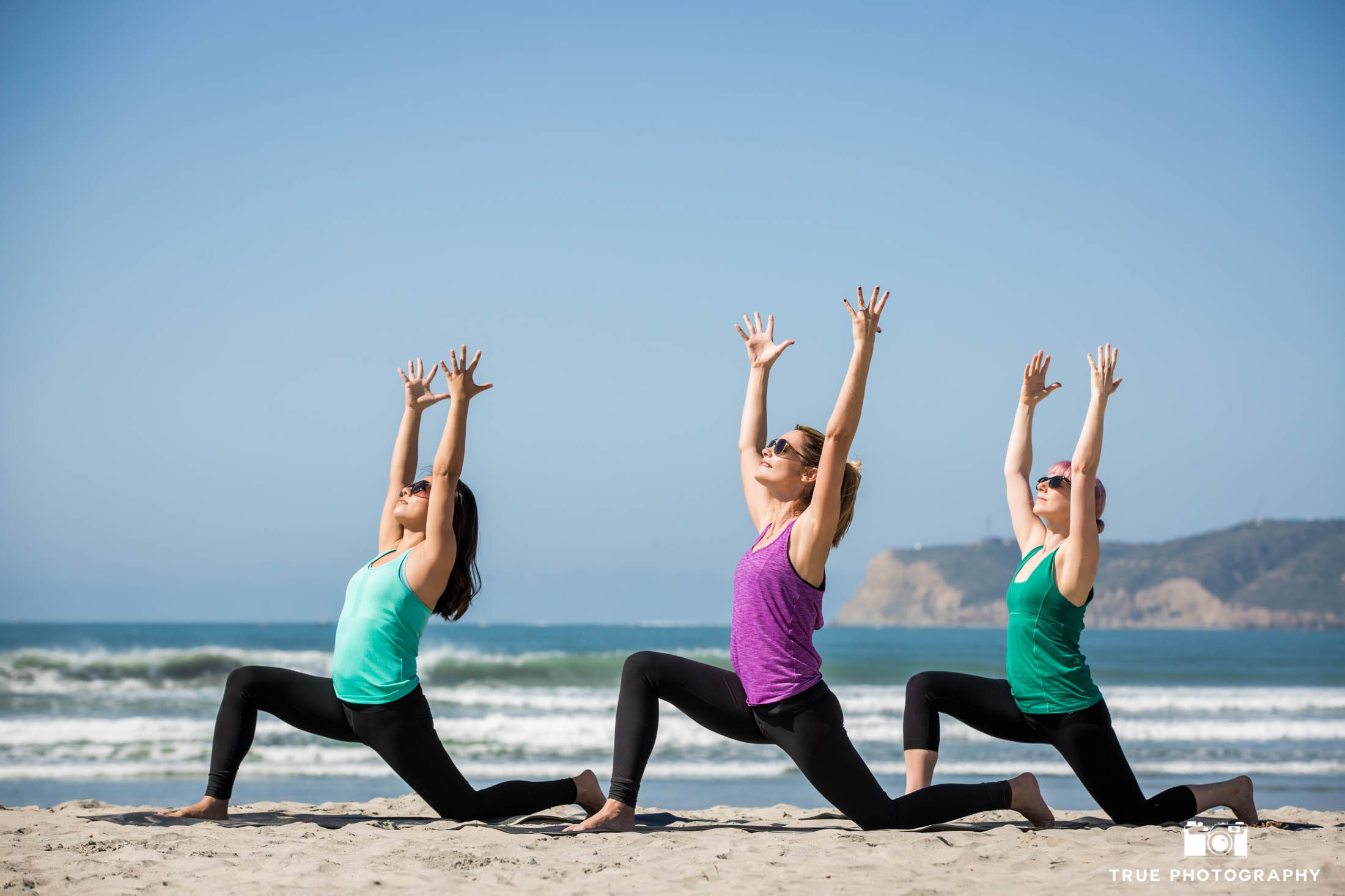 Photography of Yoga Class on the Beach