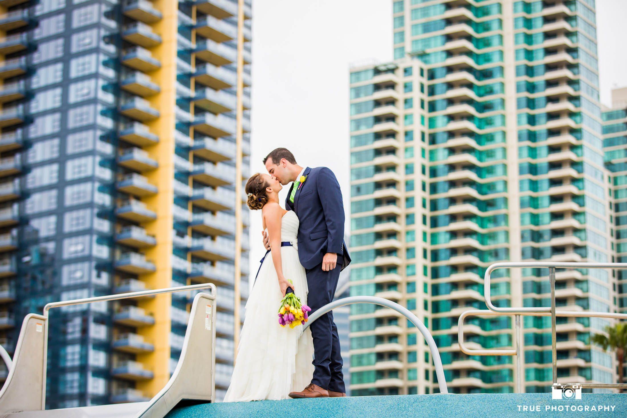 Wedding couple sharing a kiss