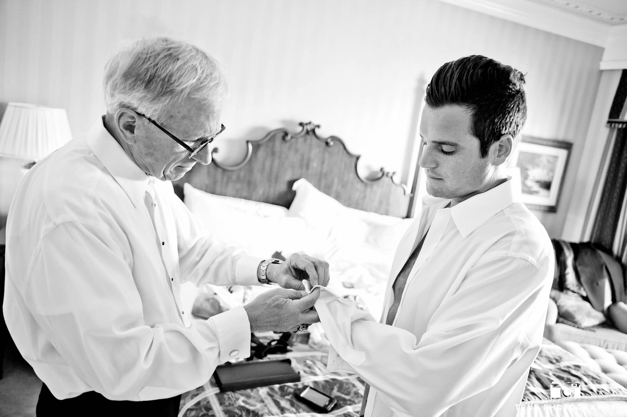 Groom's Father helps put on Cufflinks during Pre-Ceremony