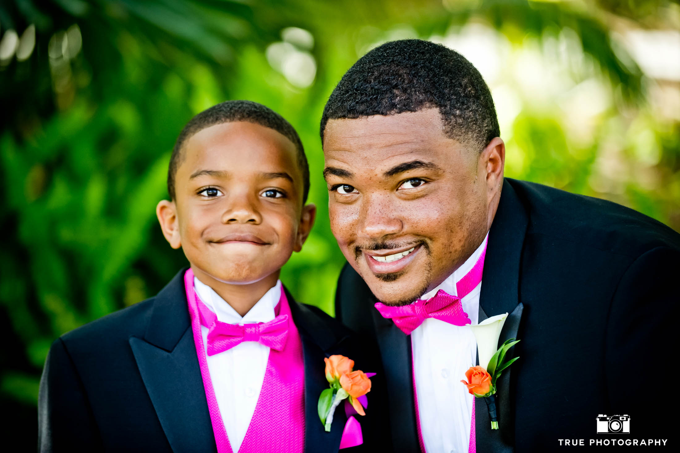 Groom and His Son in matching pink bow ties