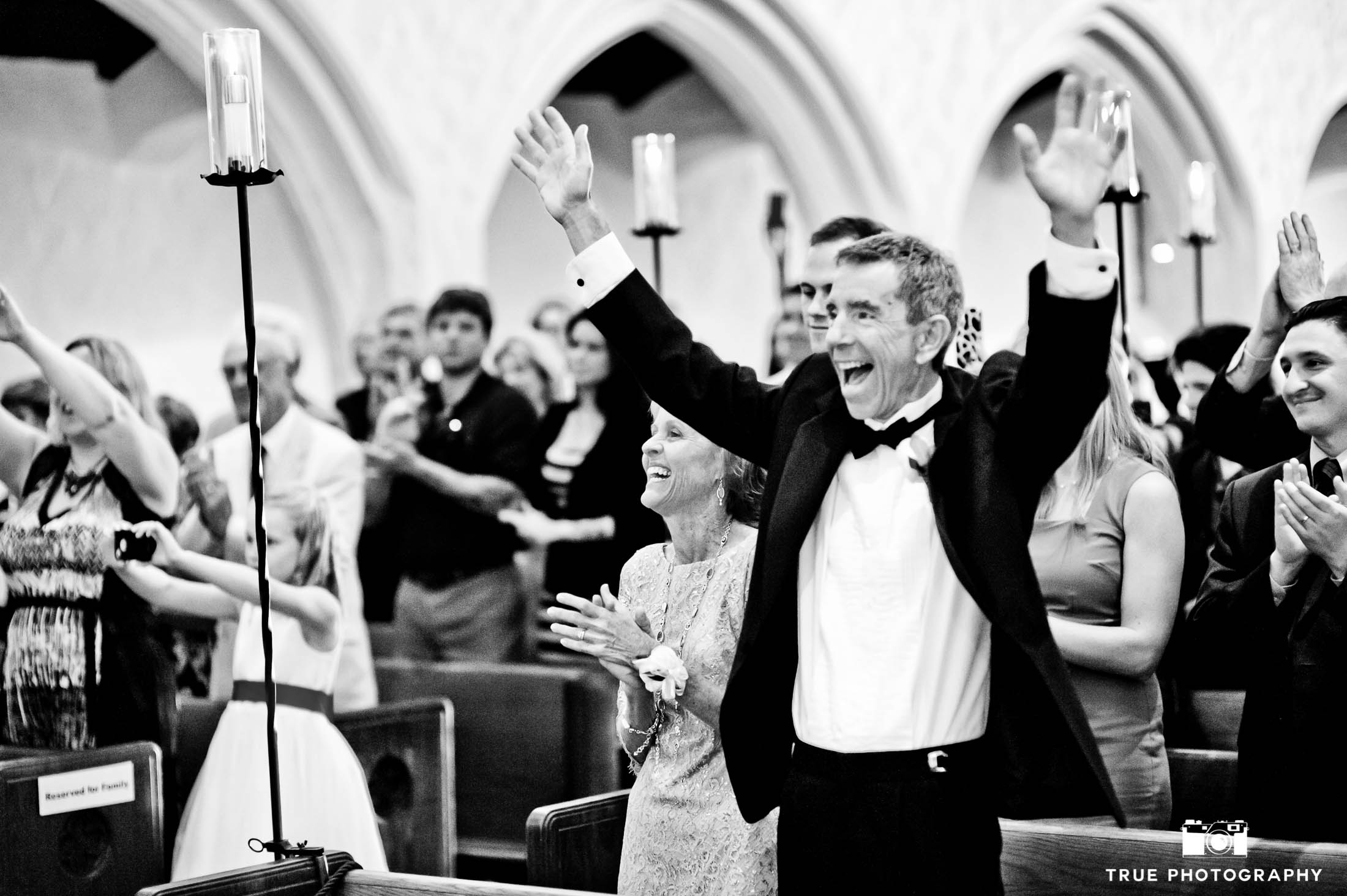 Excited Dad cheers and celebrates during wedding ceremony at church