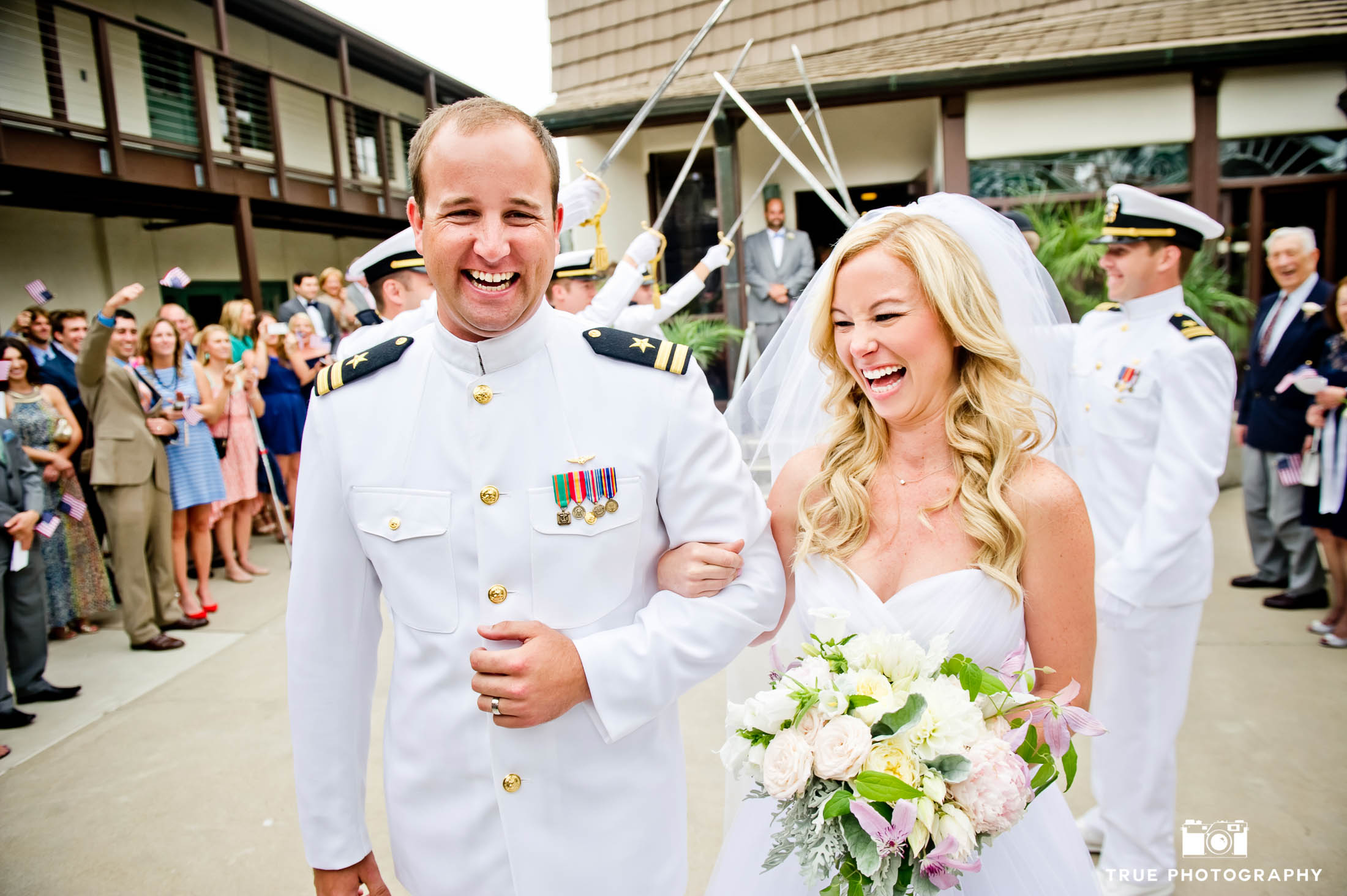 Bride and Navy military Groom exit ceremony laughing