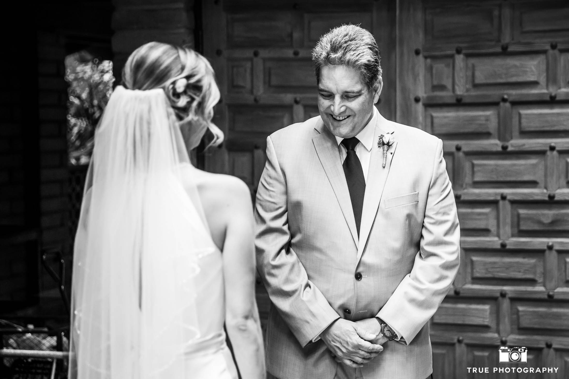 Father's happy expression during First Look with Bride