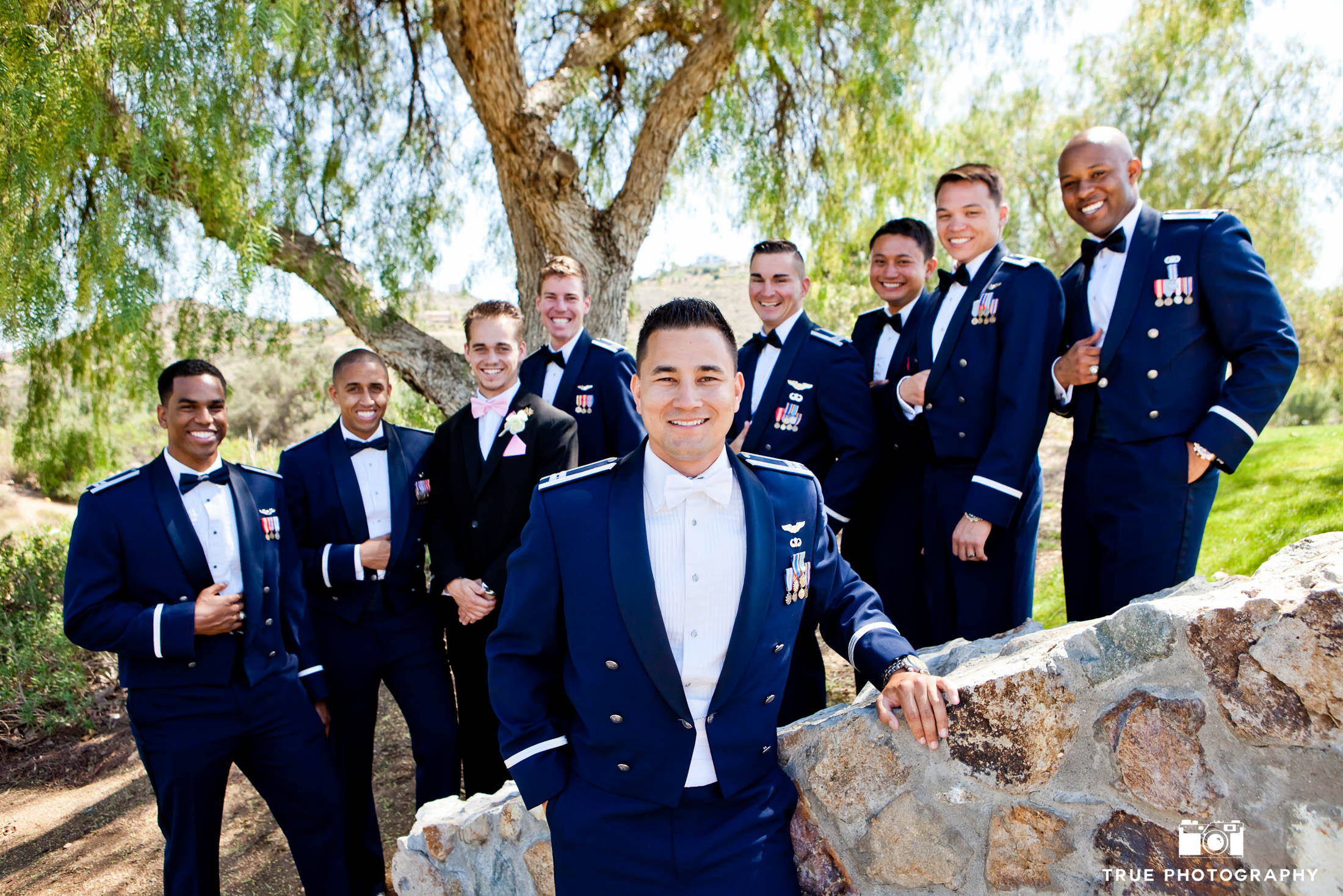 Groom with Navy military Groomsmen dressed in Blues