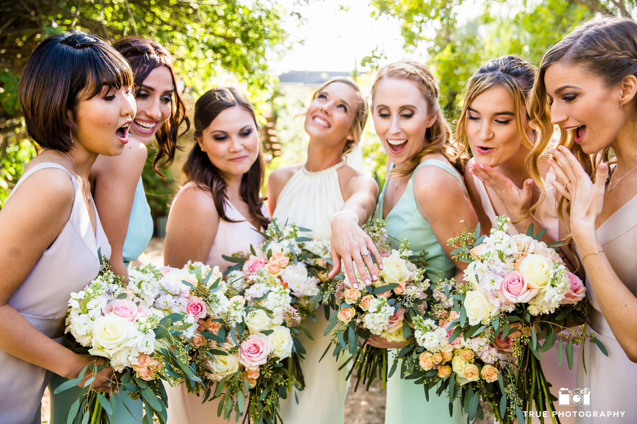 Bride shows off ring to bridesmaids for funny reaction