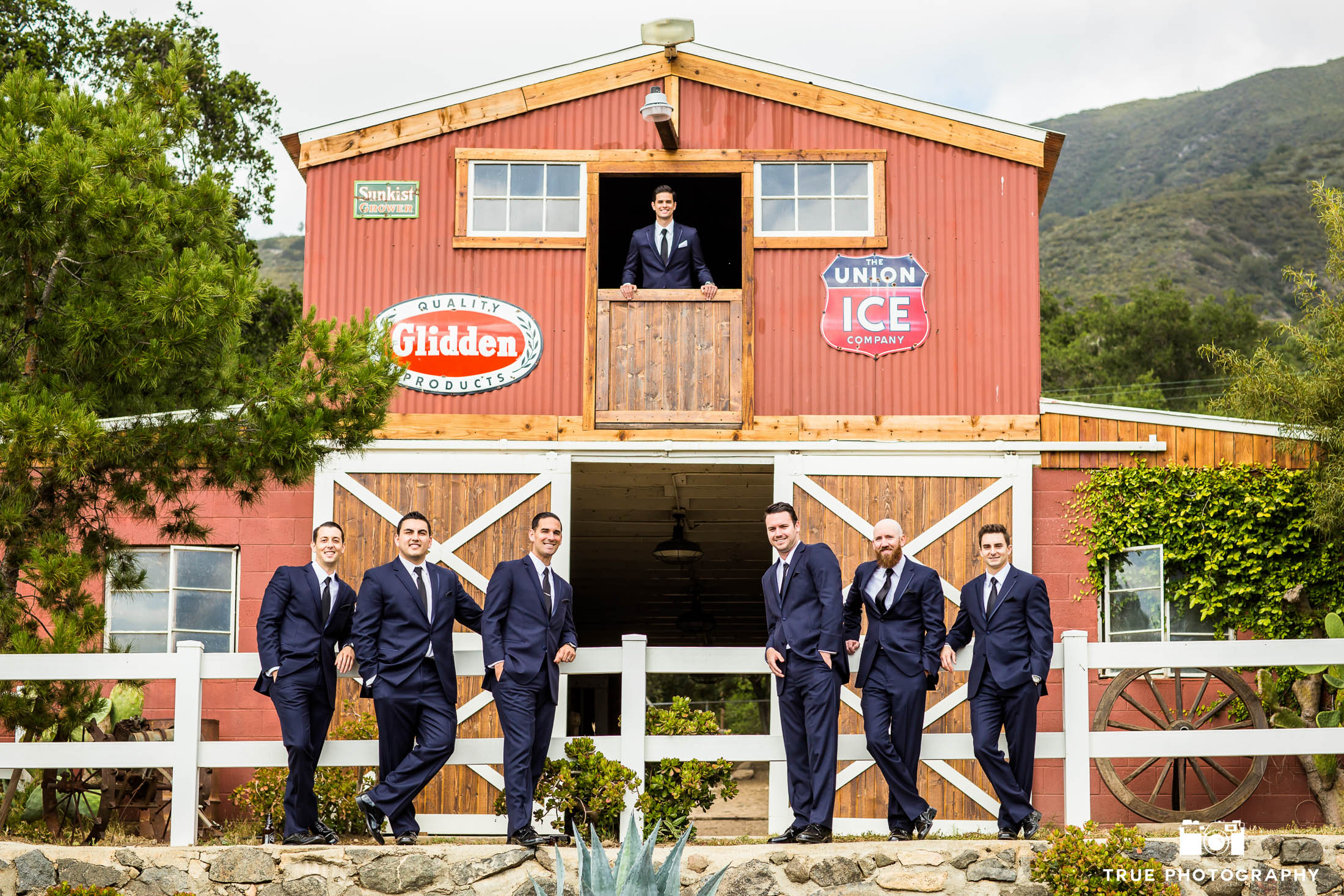 Groom and Groomsmen outside rustic barn