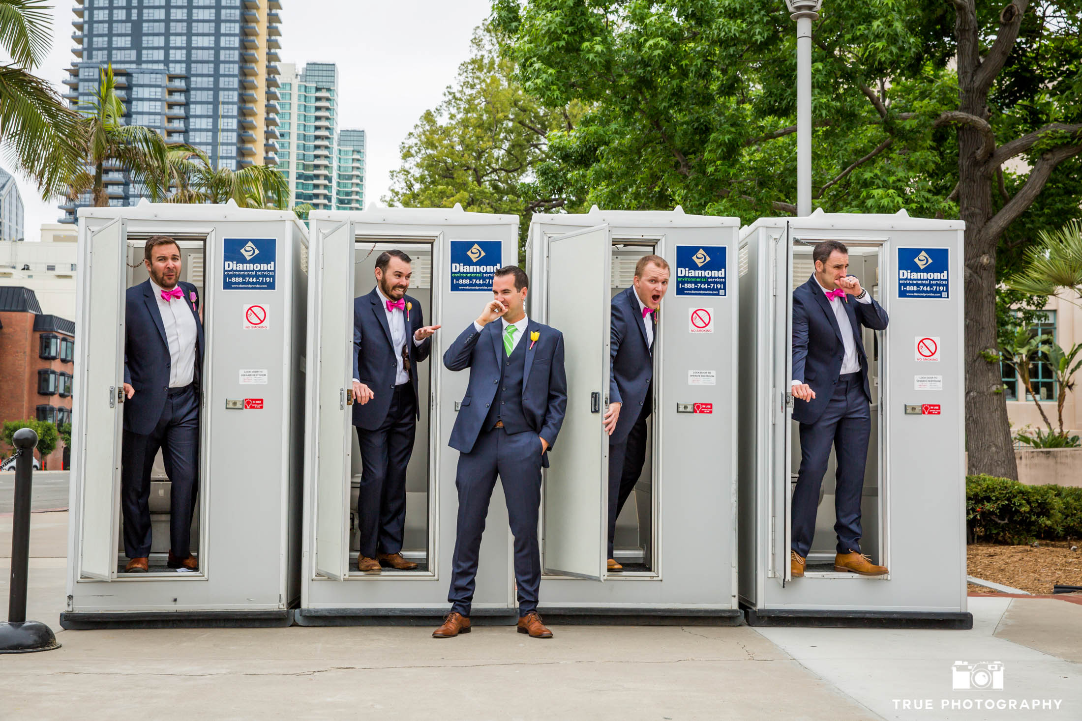 Groomsmen having some fun with the Porta Potties