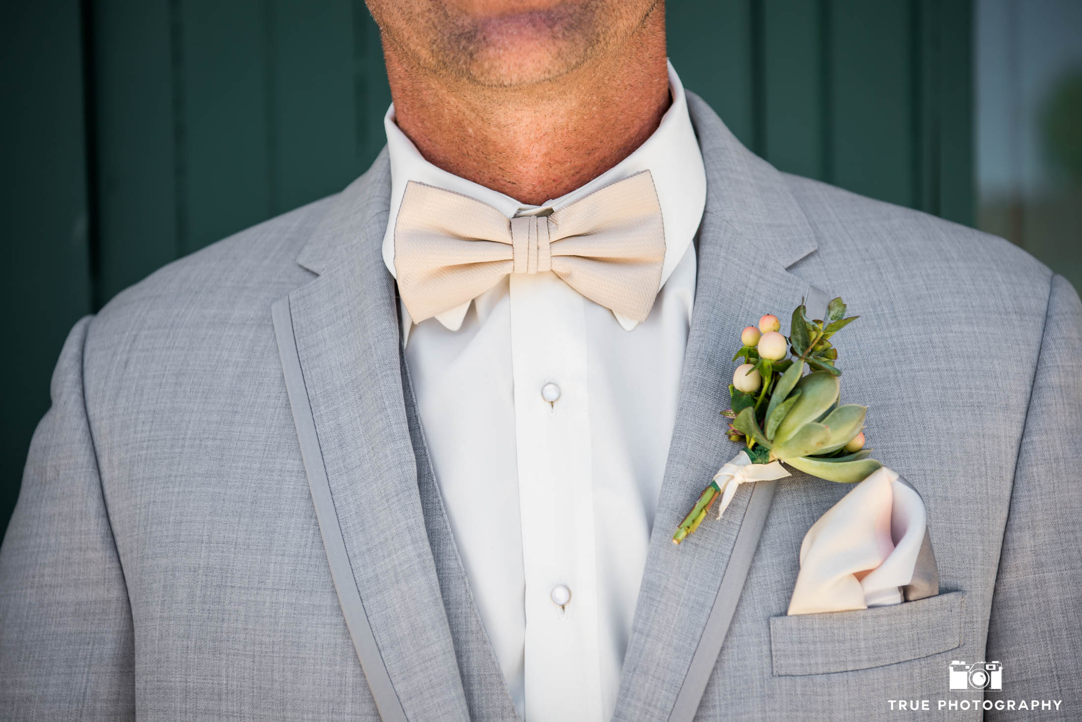 Close up of Groom's bow tie, boutonniere and pocket square