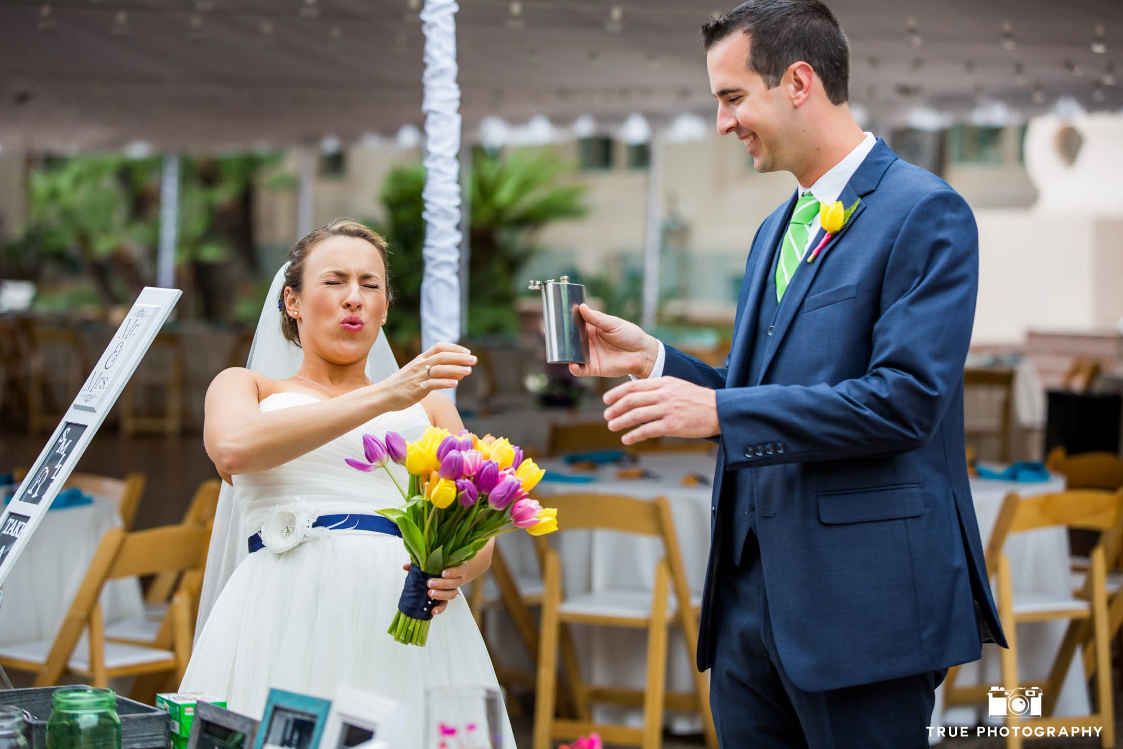 Bride having a swig from a flask