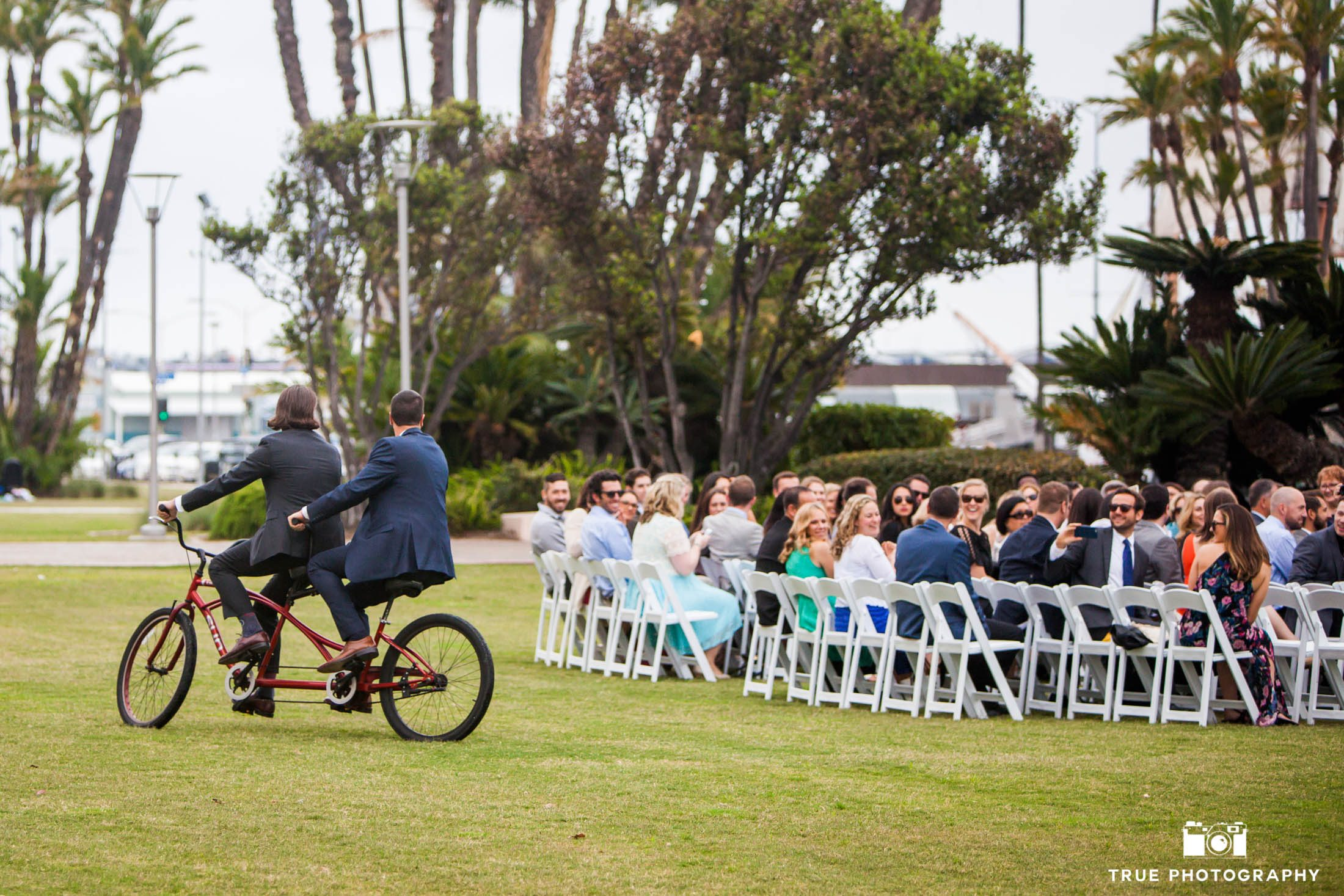 Groom and Officiant on Tandem Biicycle