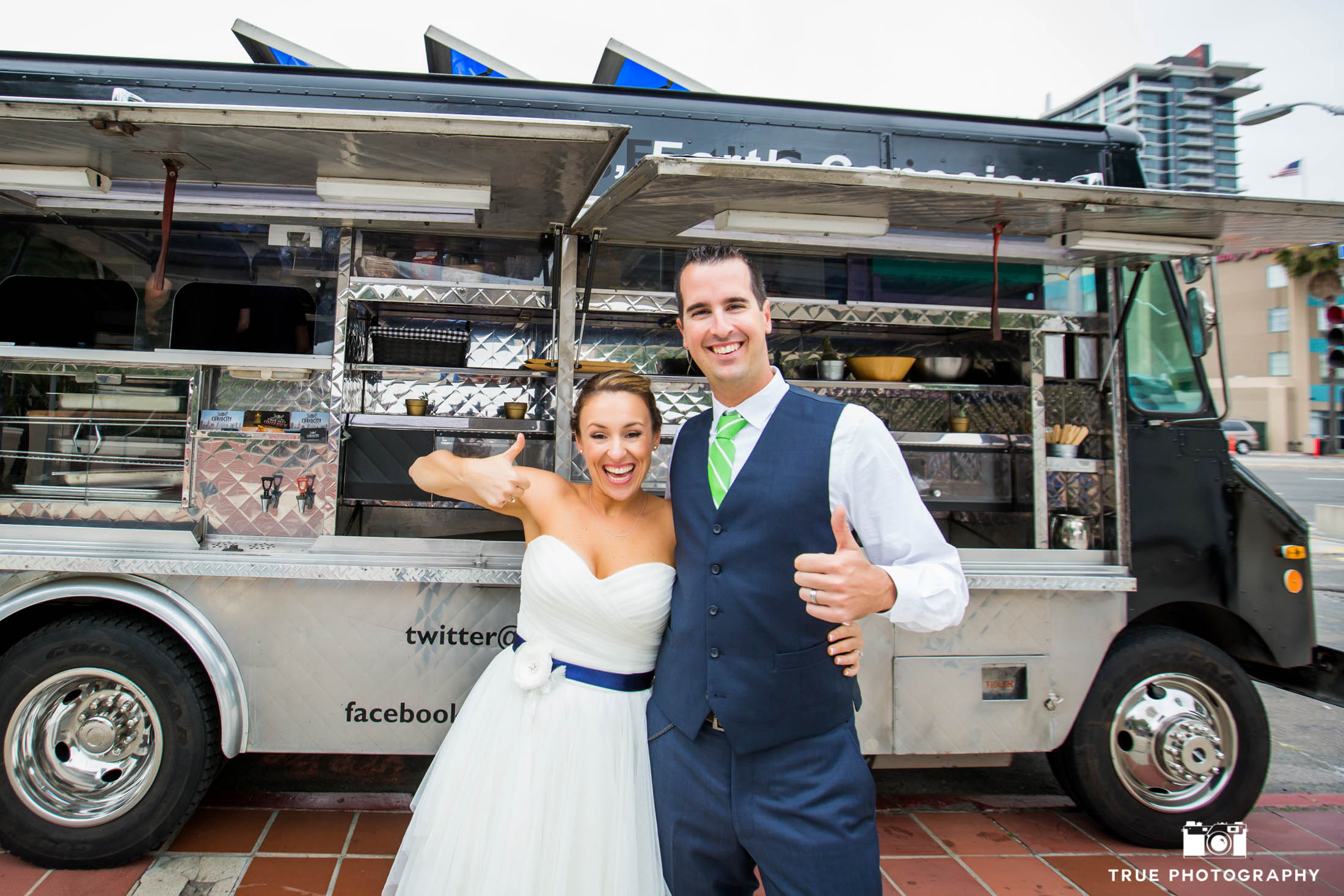 Happy food truck wedding couple
