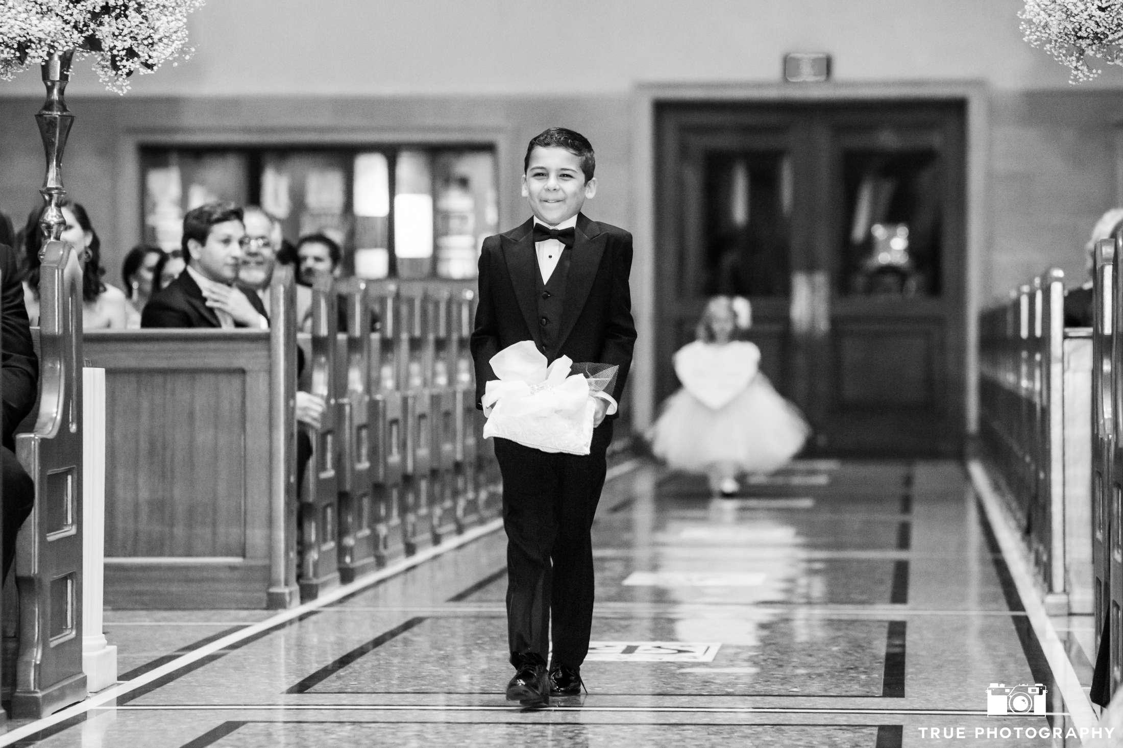 b&w of ring bearer with flower girl behind