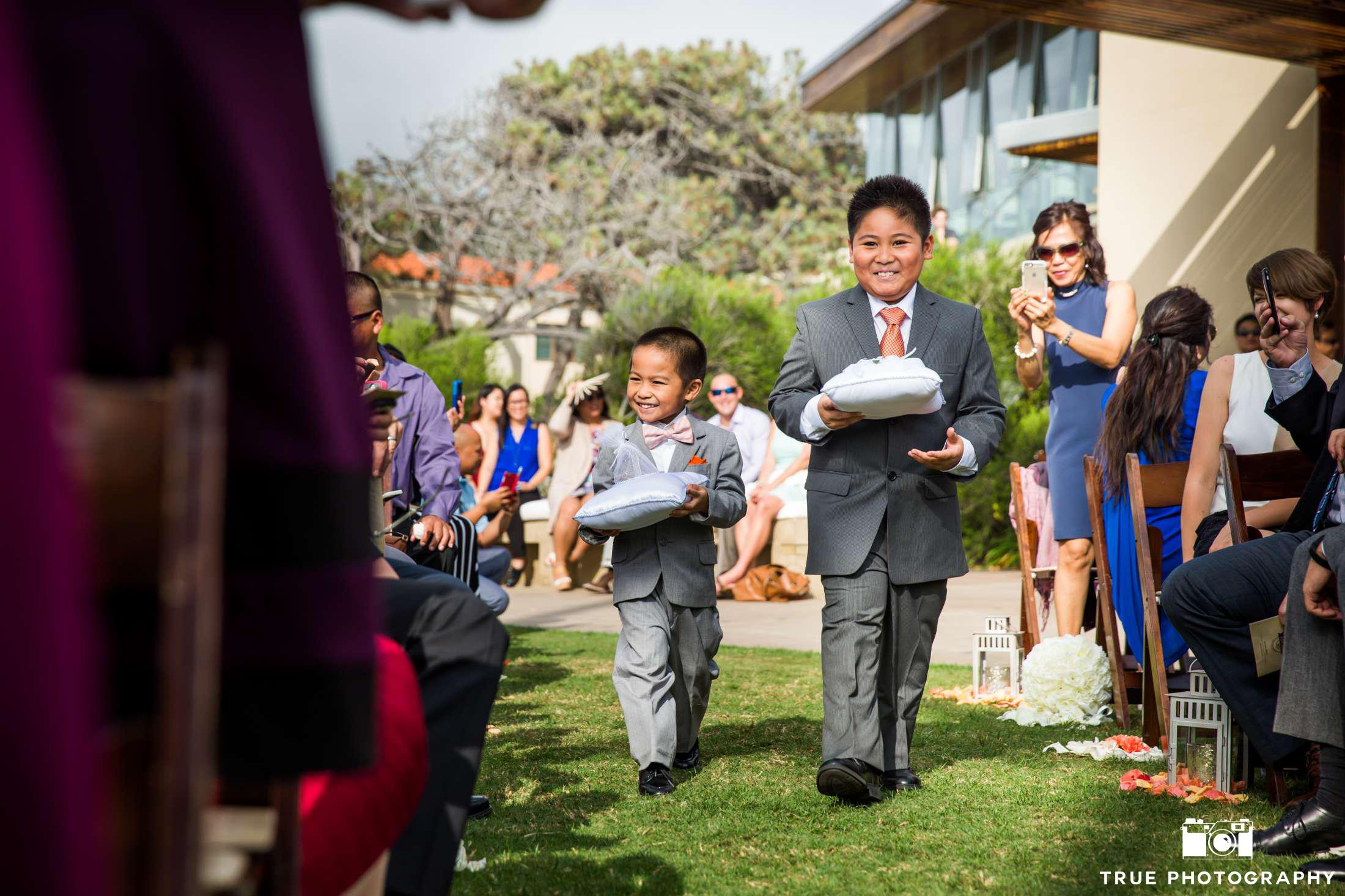 two ring bearers in gray suits