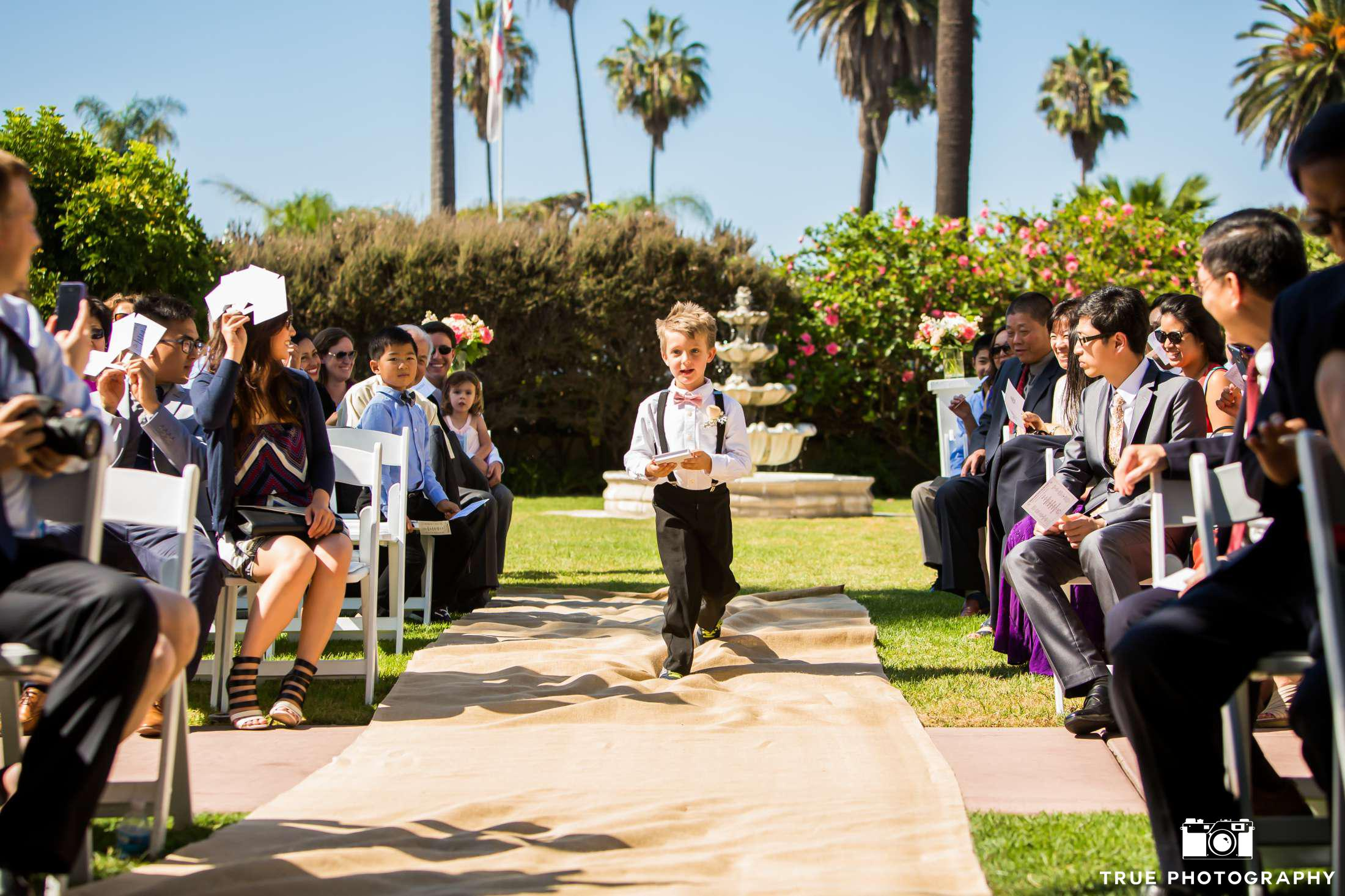 ring bearer with styled hair walking