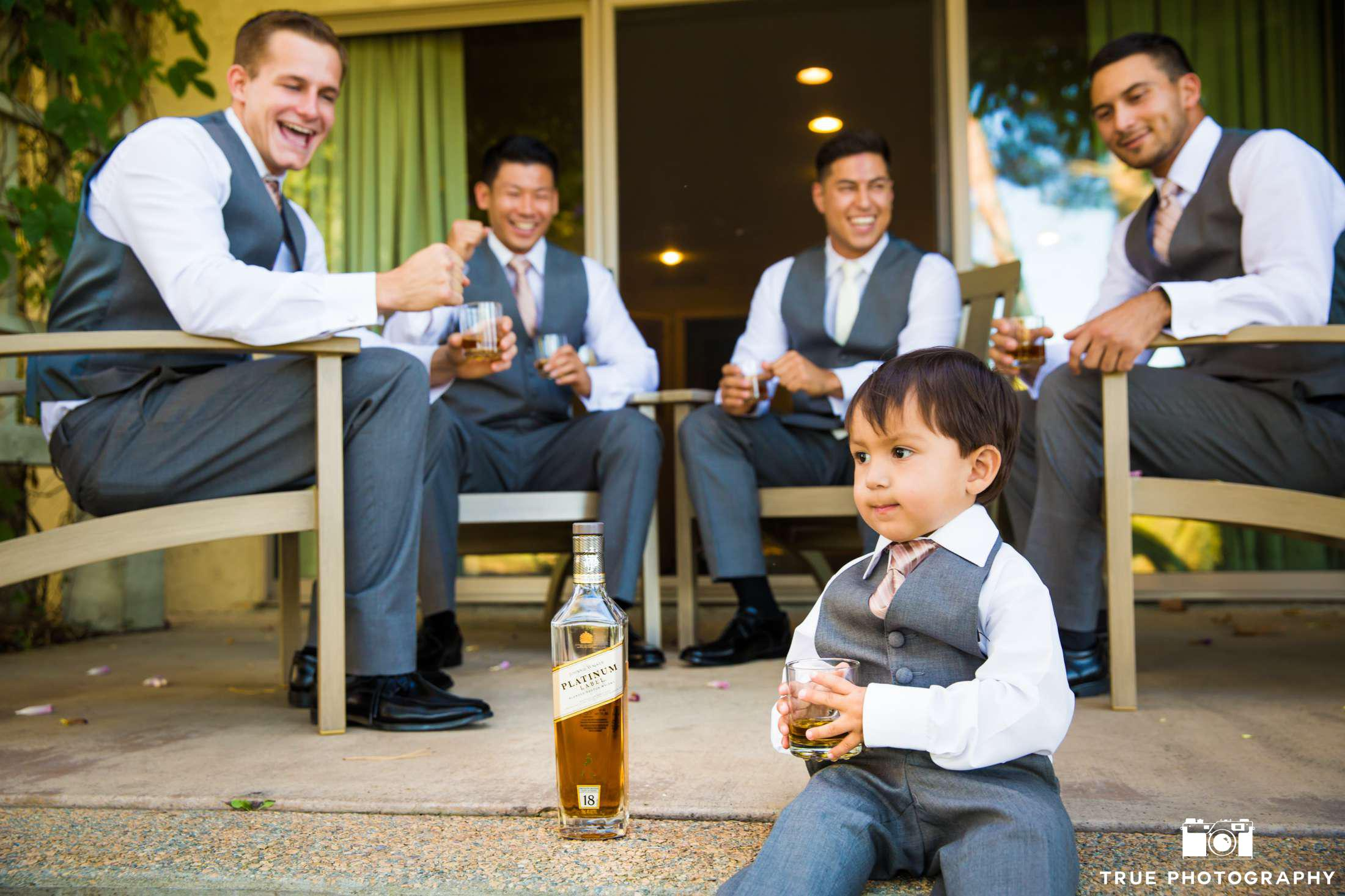 ring bearer with pretend whiskey