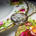 Bride's halo style interlocking wedding ring on porcelain plates
